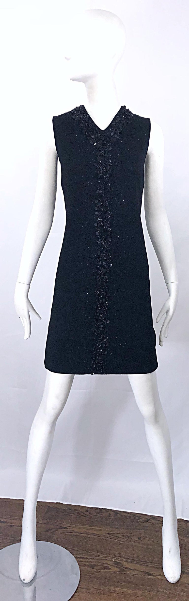 Utterly chic vintage 1960s ST. ANDREWS black zephyr wool British Hong Kong beaded and sequined shift dress! Features 100% zephyr wool that has some stretch, and is fully lined. Thousands of hand-sewn black sequins, beads and paillettes throughout