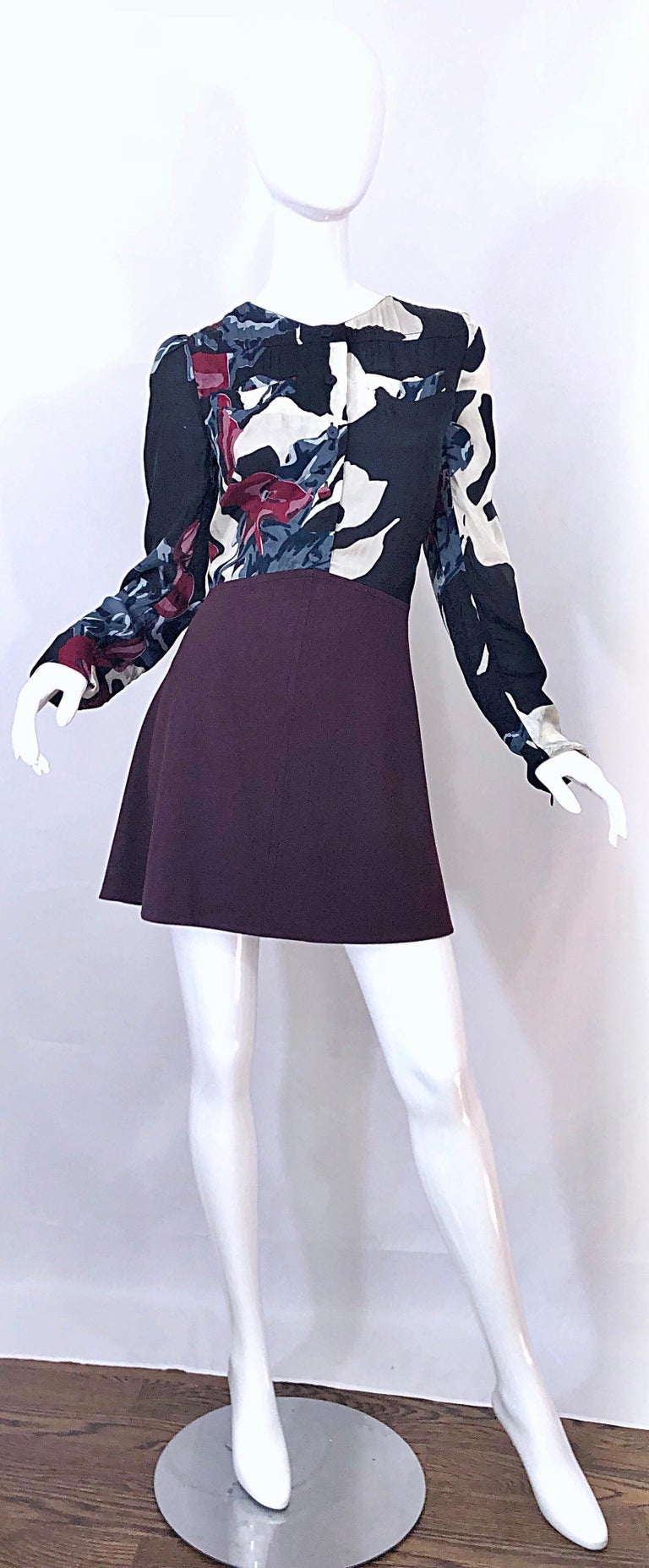 This never worn CARVEN Fall 2009 mini dress is from one of the French brand's 'revival' era in 2008. Features a rayon / viscose bodice with abstract prints in burgundy maroon, blue, black and white. Long sleeves with mock buttons up the front.