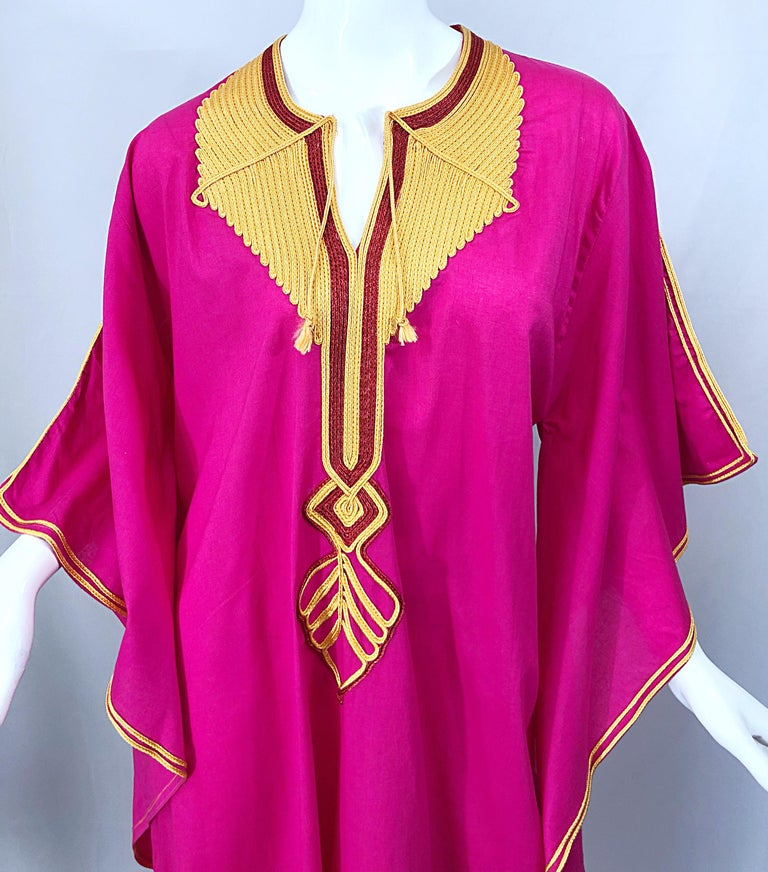 Amazing 1970s hot pink and marigold yellow angel sleeve caftan / maxi dress! Vibrant pink color, with yellow embroidery down the center and on the edges of the sleeves. Tassels at each side of the bust. Simply slips over the head. Dramatic angel