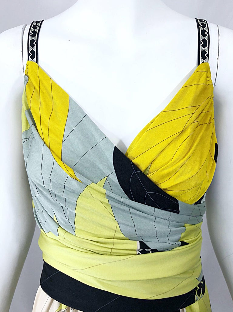 Wonderful vintage late 90s EMILIO PUCCI chartreuse green, yellow, blue and white silk jersey sleeveless dress! Features the brand's signature kaleidoscope print with signature throughout. Detachable matching belt buttons on the back. Hidden zipper