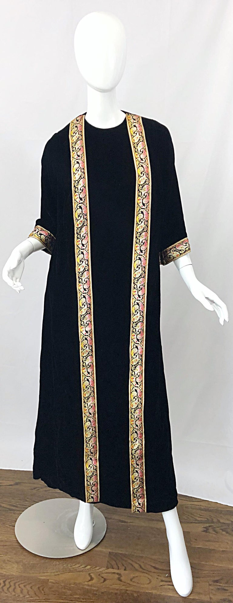 The ultimate 1960s BONWIT TELLER black rayon velvet Moroccan inspired caftan / maxi dress! Features the softest most luxurious lightweight soft rayon velvet. Wrap style, with one side wrapping around the back. Metallic embroidered paisley trim in