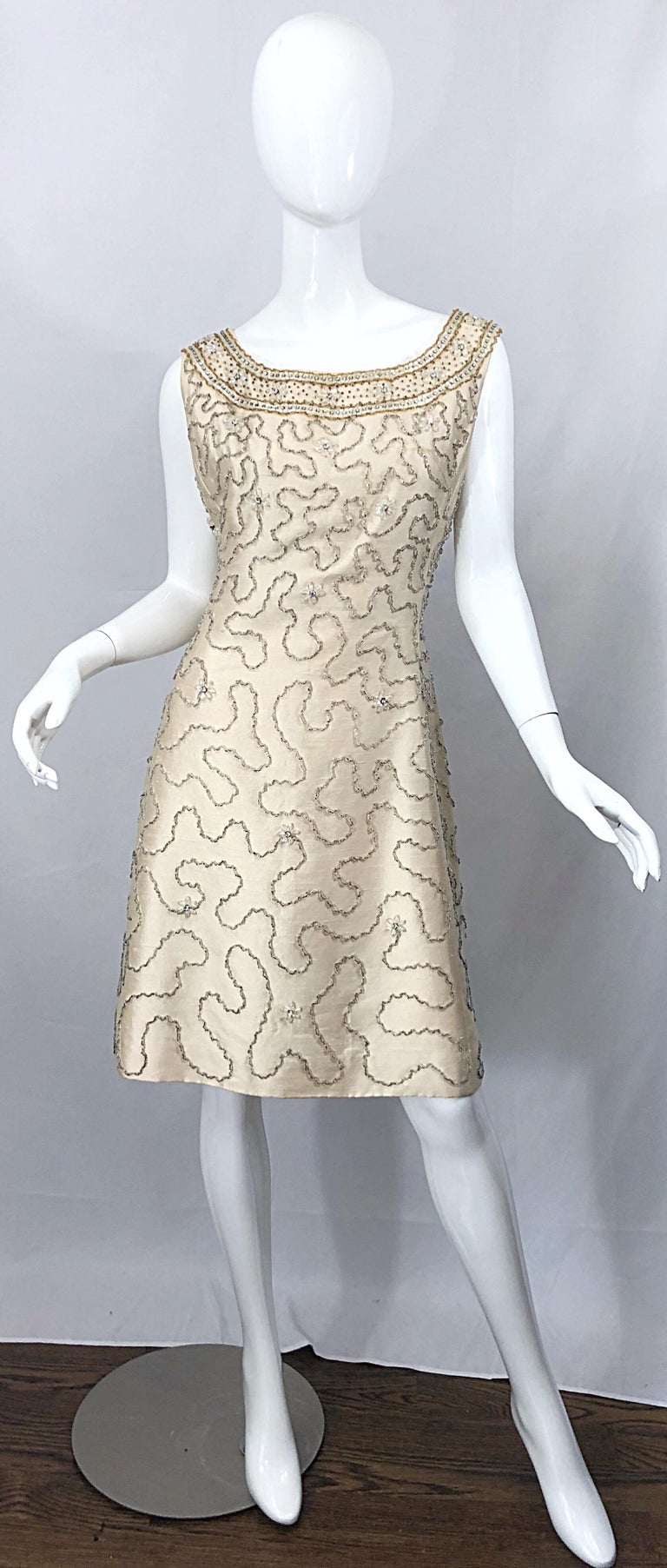 Gorgeous vintage 60s JEAN LUTECE Couture, by Roy Gaynor British Hong Kong ivory silk shantung two piece A-Line dress and swing jacket ensemble! Features wonderful silk shantung fabric. Thousands of hand-sewn beads, sequins, rhinestones, and crystals