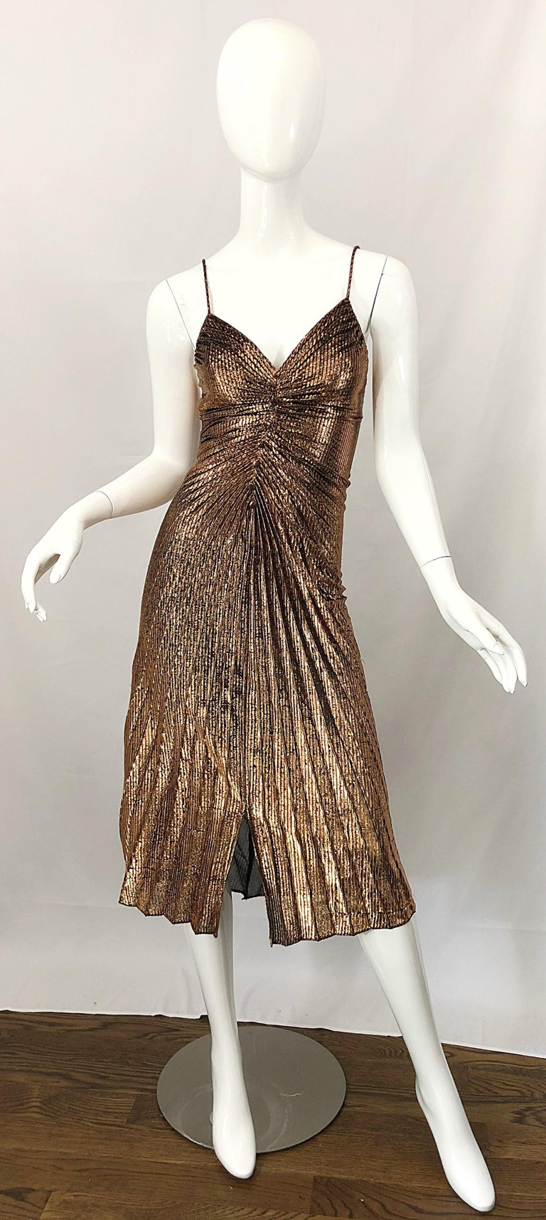 Sexy 1970s SAMIR gold / bronze metallic pleated slinky disco dress! I just love these dressed, and they are getting harder and harder to find, and always sell almost immediately! Features a flattering pleated body, with mock fabric covered buttons