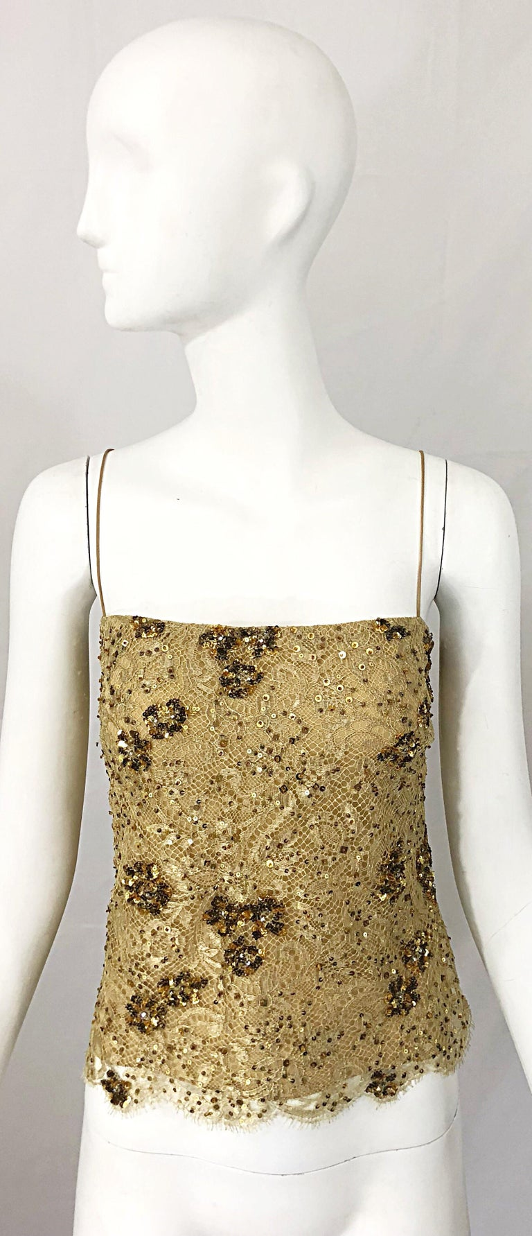 Beautiful late 1990s BADGLEY MISCHKA Couture gold lace beaded and sequined sleeveless top! Features high quality French lace. Hundreds of sequins and beads hand-sewn throughout. Hidden zipper up the side with hook-and-eye closure. Couture quality,
