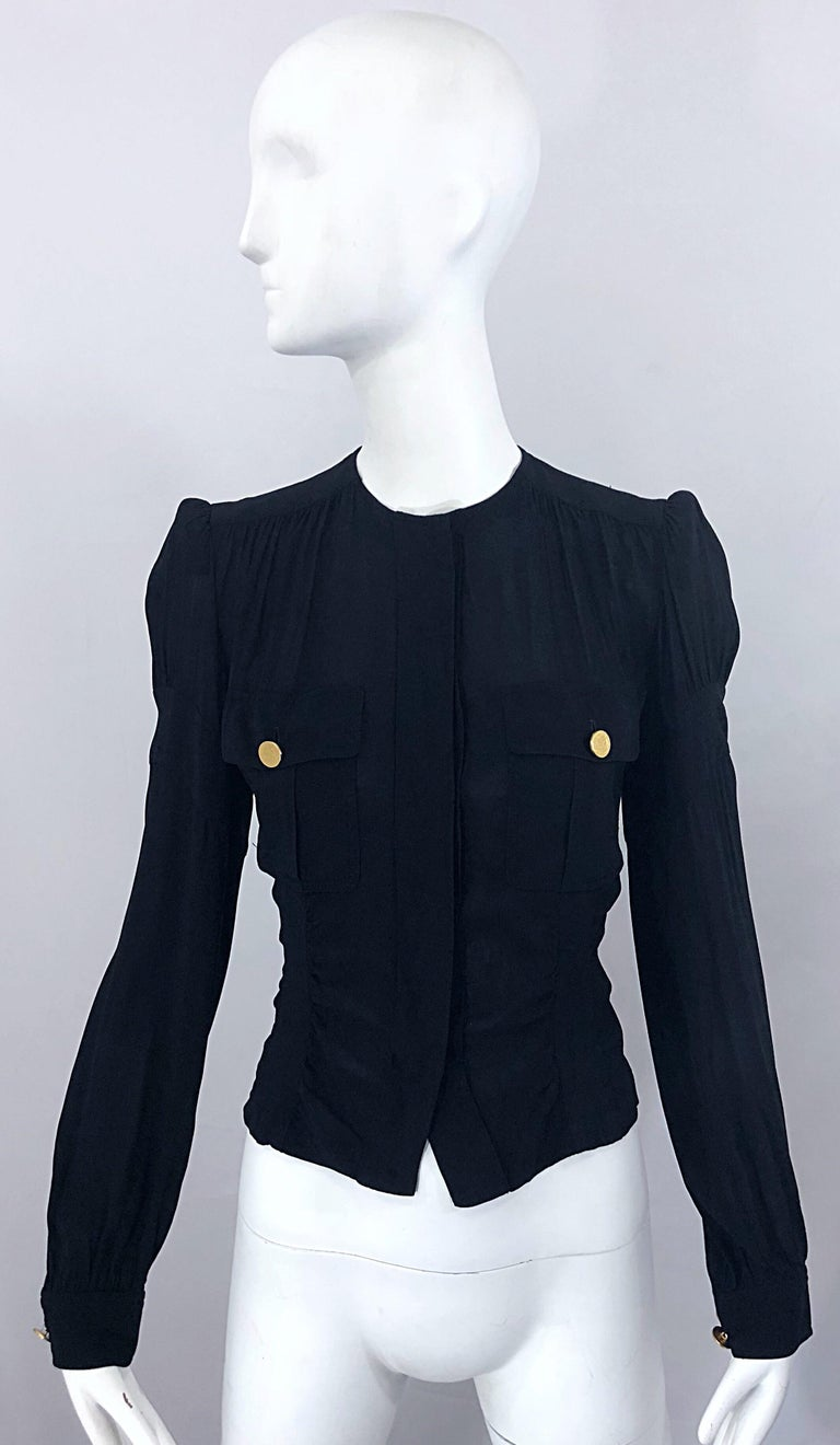 Chic 90s vintage DONNA KARAN COLLECTION black puff sleeve shirt / jacket! Features a fitted bodice with hidden gold buttons down the front and at each breast pocket. Matching gold metal buttons at back waist adjust to fit. Can easily be dressed up