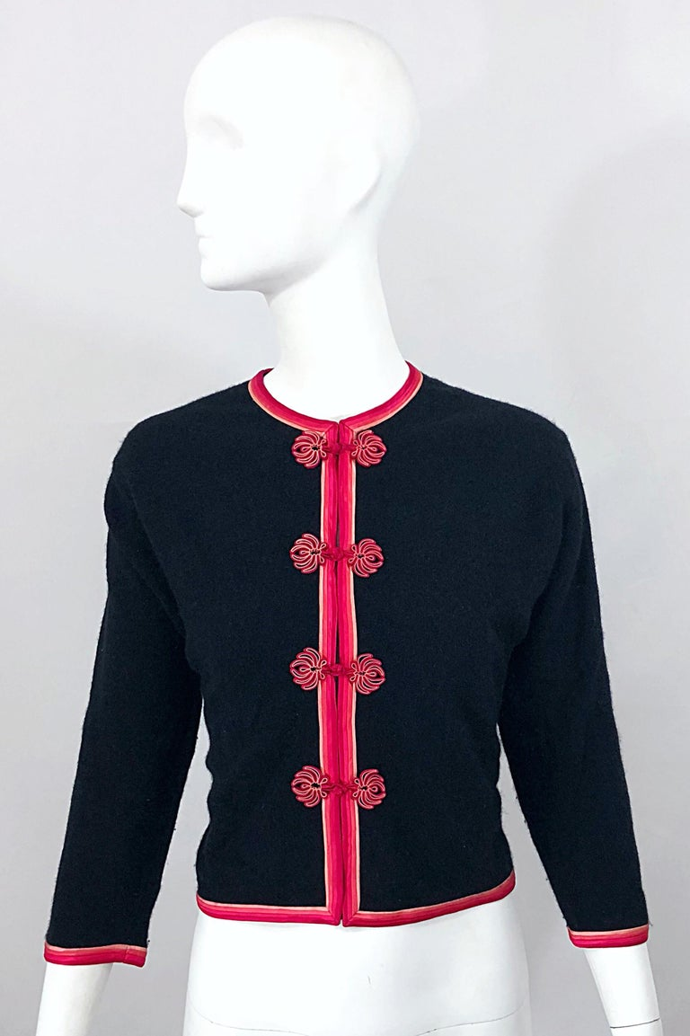 Chic stylish mid century 1950s MONHAN'S LTD. Asian black and pink soft wool cropped cardigan! Features the softest virgin wool that is fully lined. Pink and fuchsia silk ribbon detail up the center, at each sleeve cuff, around the neck, and at each