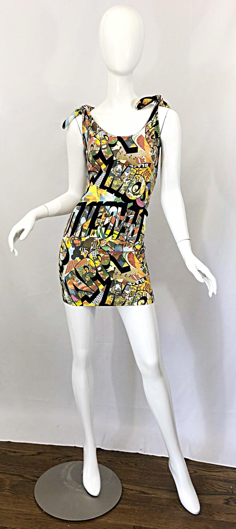 Rare and iconic 1990s MOSCHINO novelty print sexy mini dress! Features all of the cartoon characters Moschino used in the 90s. Mickey Mouse, Minnie Mouse, Popeye, Olive Oyl, amongst others. Hidden zipper up the side. Comfortable Cotton (98%) and