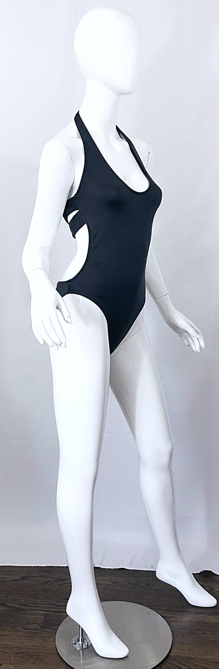 Sexy never worn 90s vintage CALVIN KLEIN slate grey  one piece cut-out swimsuit or bodysuit! The perfect alternative to black, this beauty features just the right amount of metallic sheen. Criss-cross cut out back. Easy to wear, and super slimming.