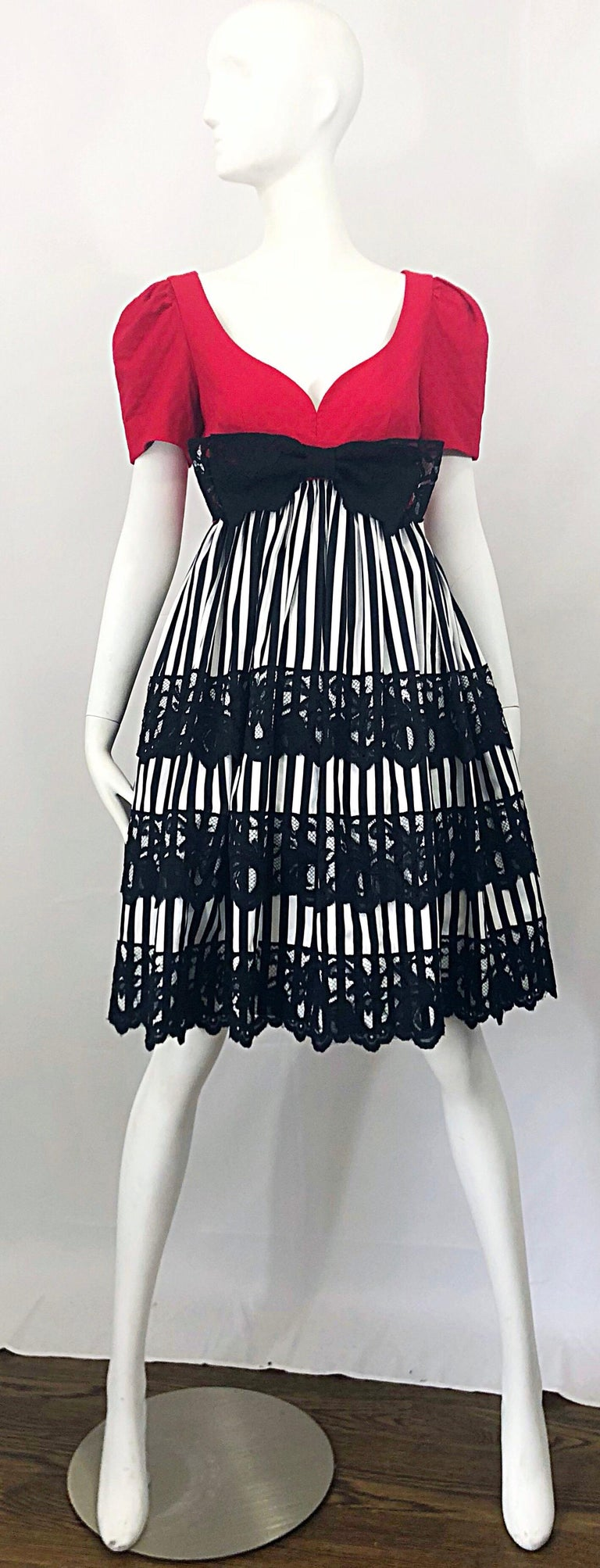 Insanely chic vintage ADELE SIMPSON red, black and white  fit n' flare cocktail dress! Features a fitted red cotton pique bodice with a sweetheart neckline. Empire waist with a black and white striped silk skirt. Three black lace panels on the