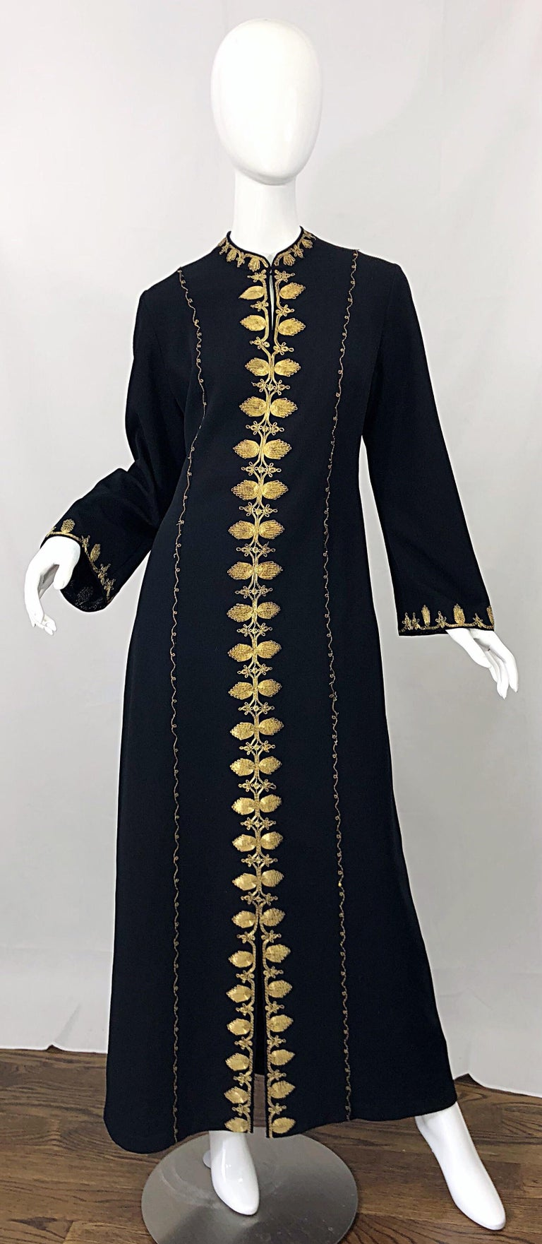 Amazing 1970s black crepe Moroccan long sleeve kaftan maxi dress! Features meticulously embrodiered gold metal throughout. Chic bell /angel sleeved have just the right amount of flare. Hook-and-eye closure at top neck creates a keyhole affect, or