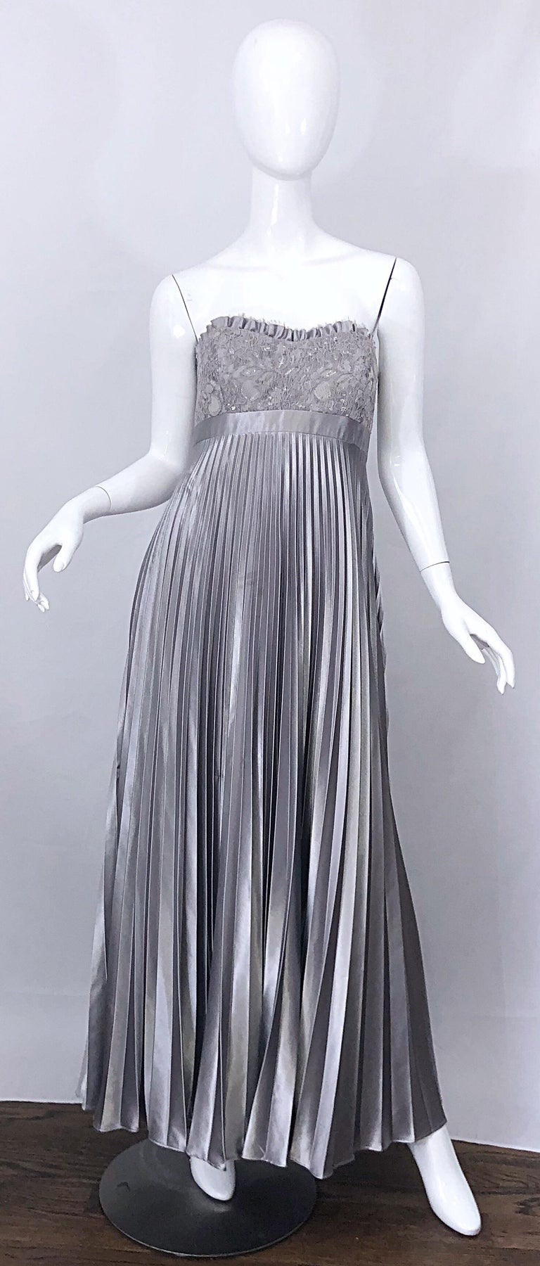 Beautiful vintage 90s BADGLEY MISCHKA Couture quality metallic silver gray strapless evening gown! Features a fitted boned lace bodice with silver sequins hand-sewn throughout. Flattering and forgiving empire waist accordian pleated skirt. Hidden
