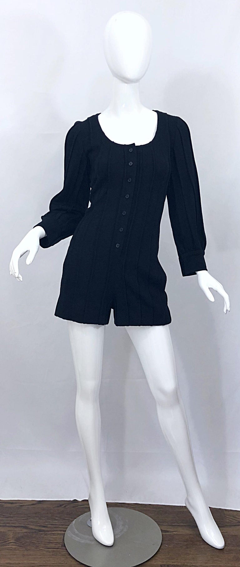 Chic vintage GIVENCHY HAUTE COUTURE black wool long sleeve one piece romper jumpsuit! Features soft black ribbed virgin wool. Buttons up the front. Pockets at each side of the hips. Buttons at each sleeve cuff, which can also be rolled up. Can