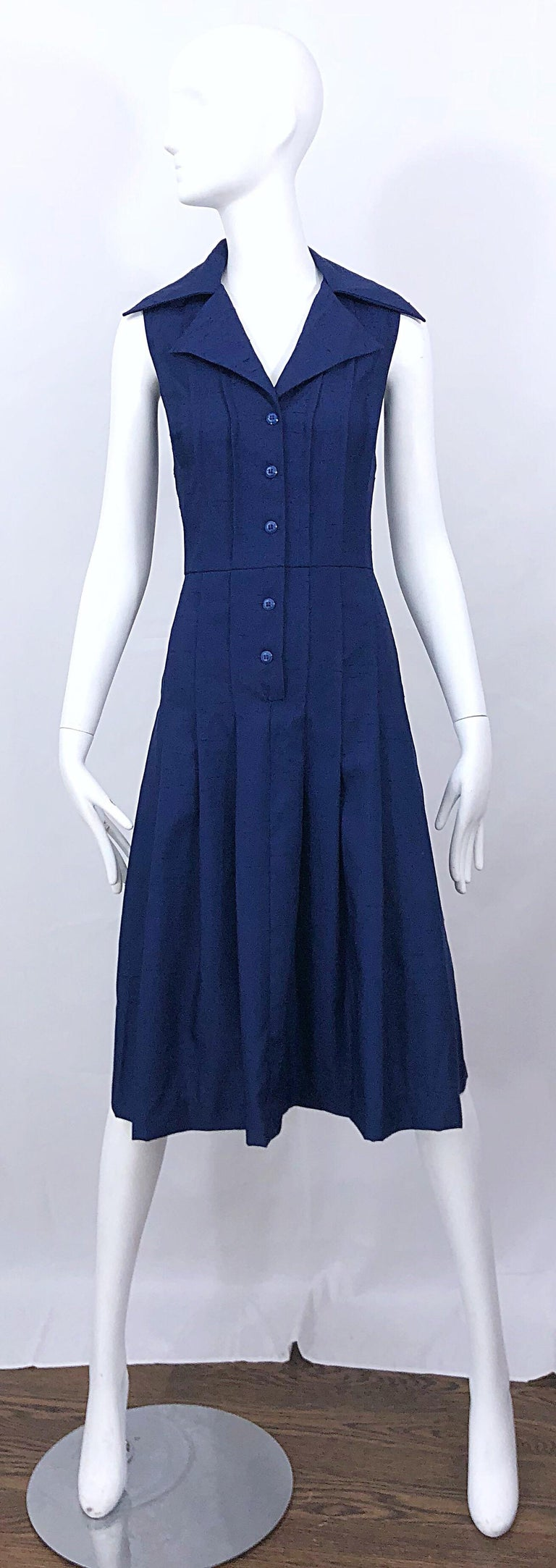 Chic beuatiful early 90s SAKS 5TH AVE. navy blue size 10 sleeveless silk fit n' flare shirt dress! Buttons up the bodice. 1950s style with a fitted bodice and a forgiving full skirt. Avant Garde oversized pointed collar. The perfect dress that can