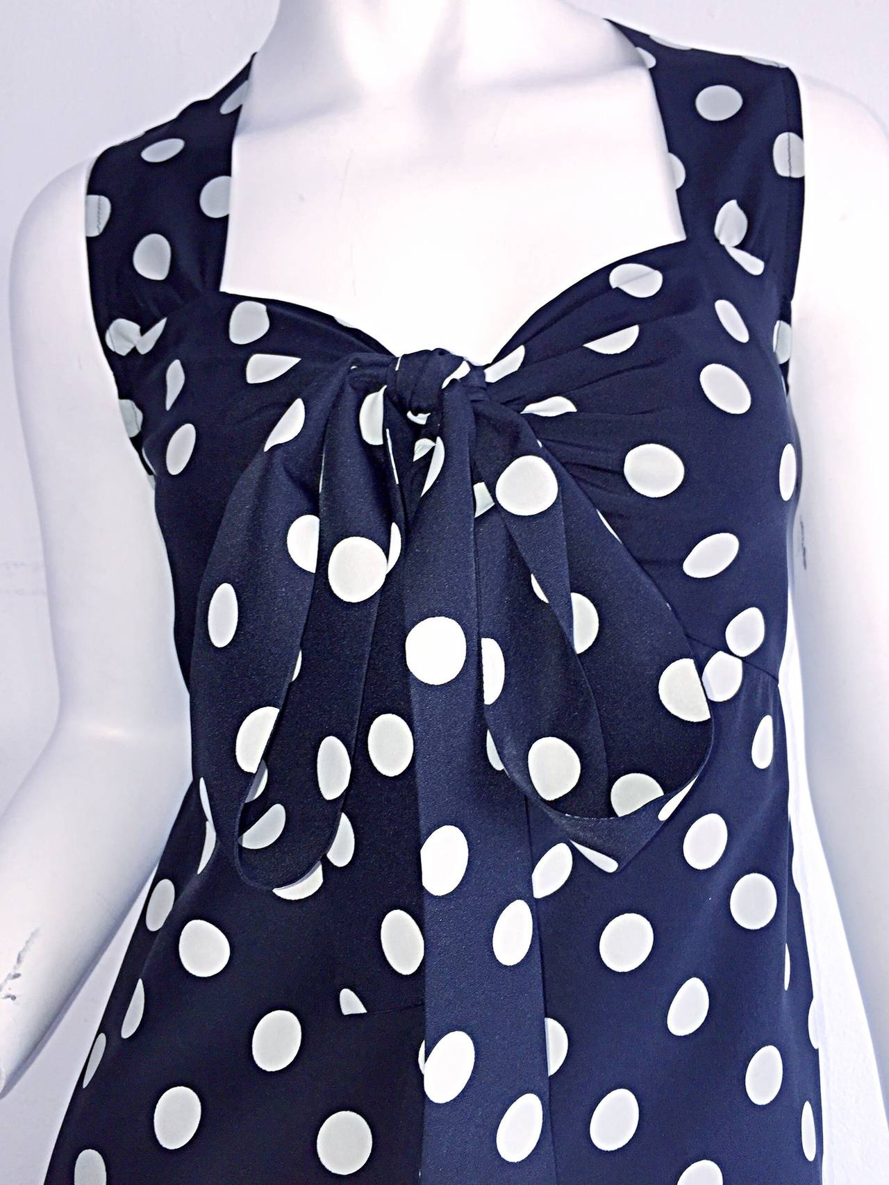 "Extremely chic vintage YSL ""Rive Gauche"" navy blue & white polka dot babydoll style dress! 100% Silk, with detachable bust piece that can be tied in a bow, left hanging, or used as a belt. The perfect dress! Double silk. Made in France. In great"