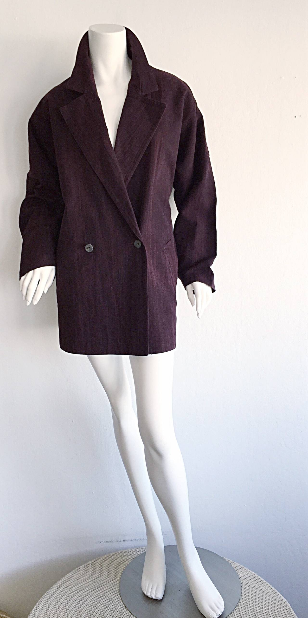 Only Issey Miyake could offer such a profound cut on a double breasted kimono style blazer! Beautiful cordovan color, with natural variations throughout the jacket. Wonderful slouchy fit, with dolman-like sleeves. Pockets at both sides of the waist.