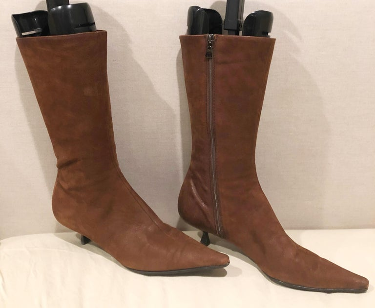 Stylish early 2000s PRADA Size 38.5 (US 8.5) medium brown mid calf kitten heel boot! The perfect length in between ankle boots and knee high boots! Zipper up the inner ankle. Leather soles with rubber protection to prevent slipping. Super