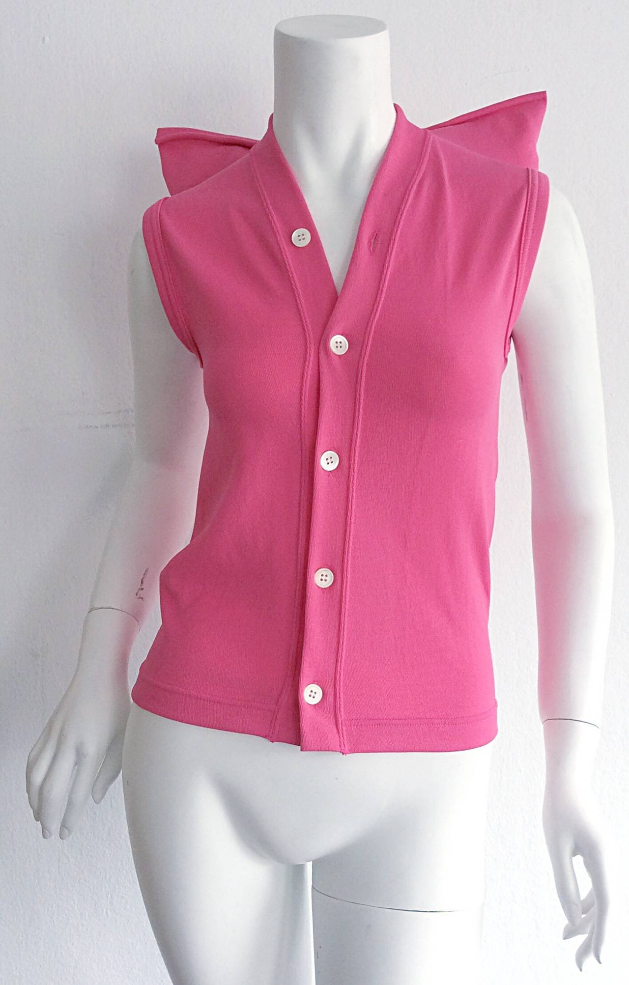 Amazing Avant Garde vintage Comme des Garcons hot pink top! Amazing shoulder detail. Buttons up the bodice. Can easily be dressed up or down. Looks great belted, or alone. In great condition. Will fit Small-Medium, due to stretch.