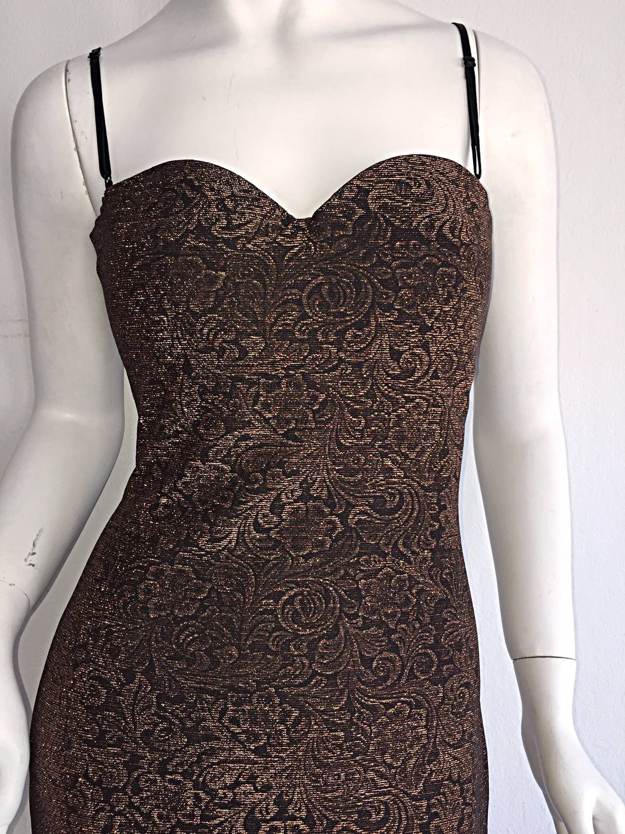 Stunning vintage Casadei bronze metallic dress! Intricate print, that shines, and flatters the body like no other when worn! Features adjustable convertible straps that easily tuck in for a strapless look. Beautiful sweetheart bust. Looks great