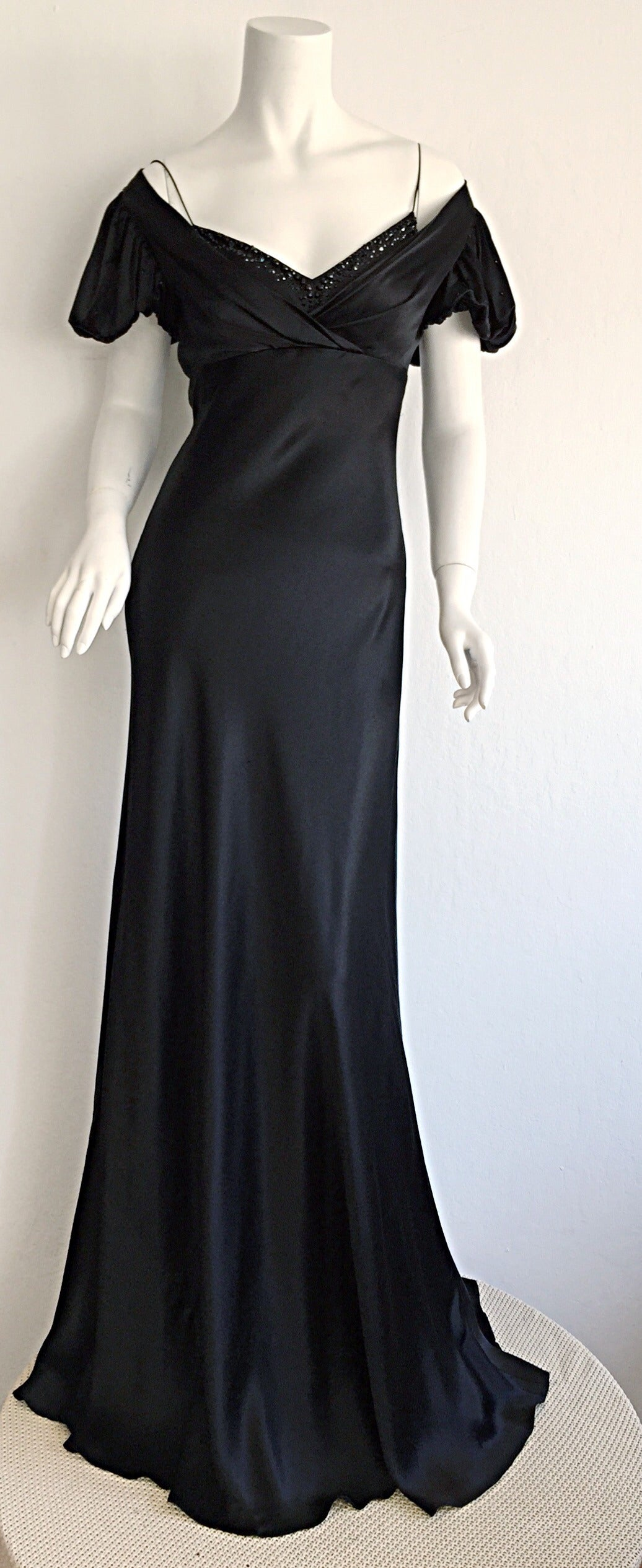 Incredibly gorgeous vintage 1990s Jenny Packham gown. Layers and layers of the highest quality black silk! Built in jeweled bodice that peeks through bust, with silk spaghetti straps. Can be worn on, or off shoulders. Truly stunning fit, that looks
