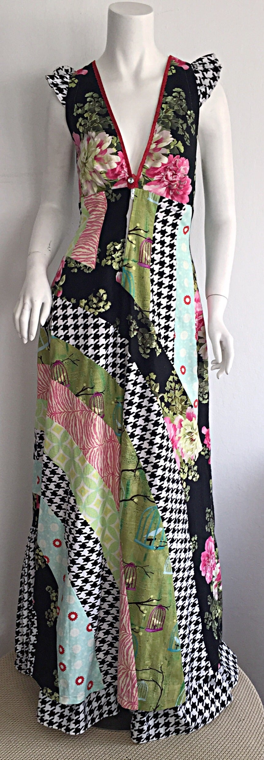 Awesome 1970s patchwork dress! Beautiful ruffles at sleeves, with plunging neckline, and rhinestone at bust. Lace trim at bust. Layers and layers of cotton, with various patchwork prints throughout. Impeccable construction. Perfect with sandals or