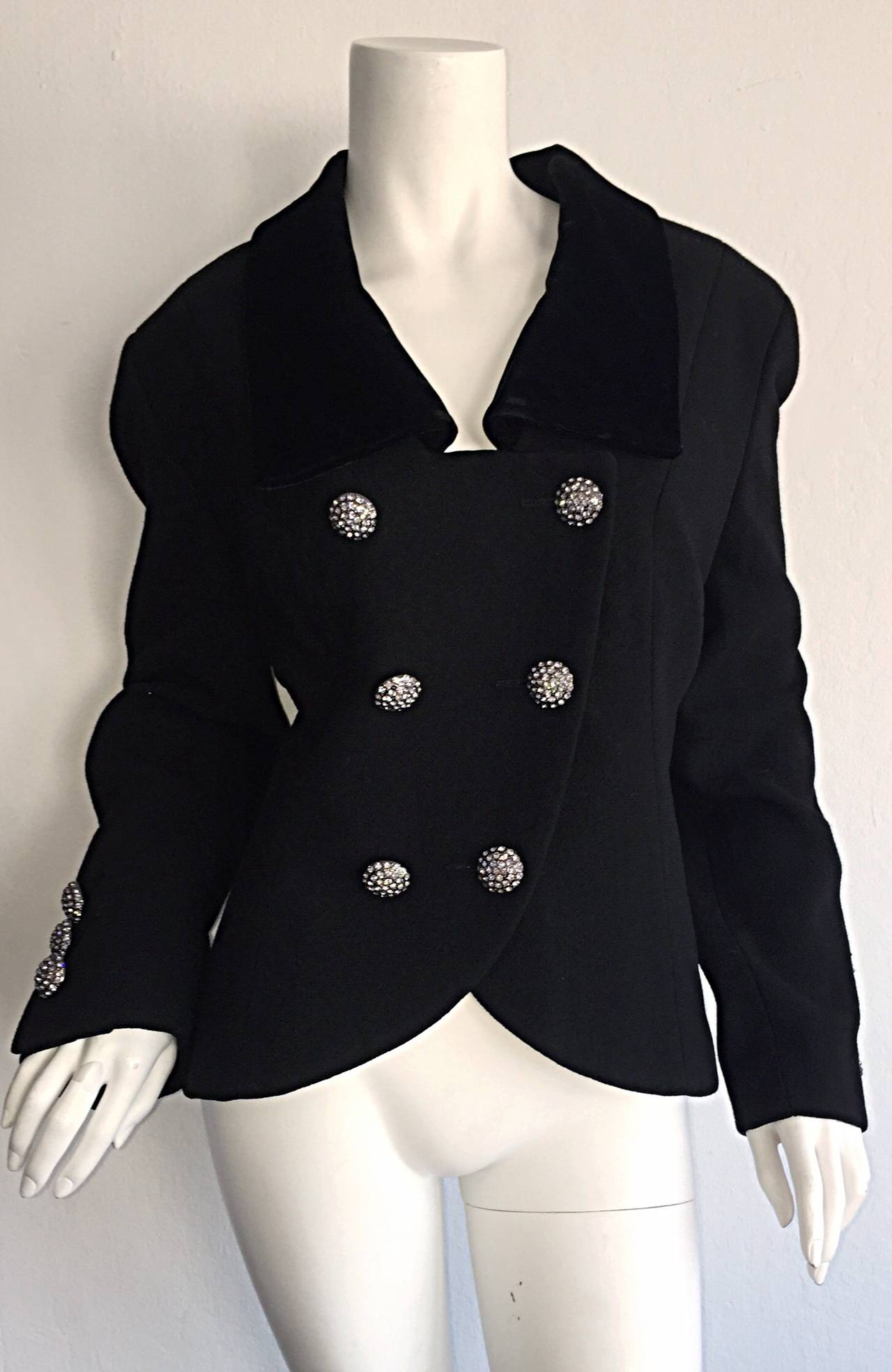 Beautiful vintage Andrea Odicini Couture black skirt suit! I love the fact that both pieces are equally as impressive as separates, and can easily make their way into any wardrobe! Rhinestone buttons on double breasted blazer at bodice, and cuffs.