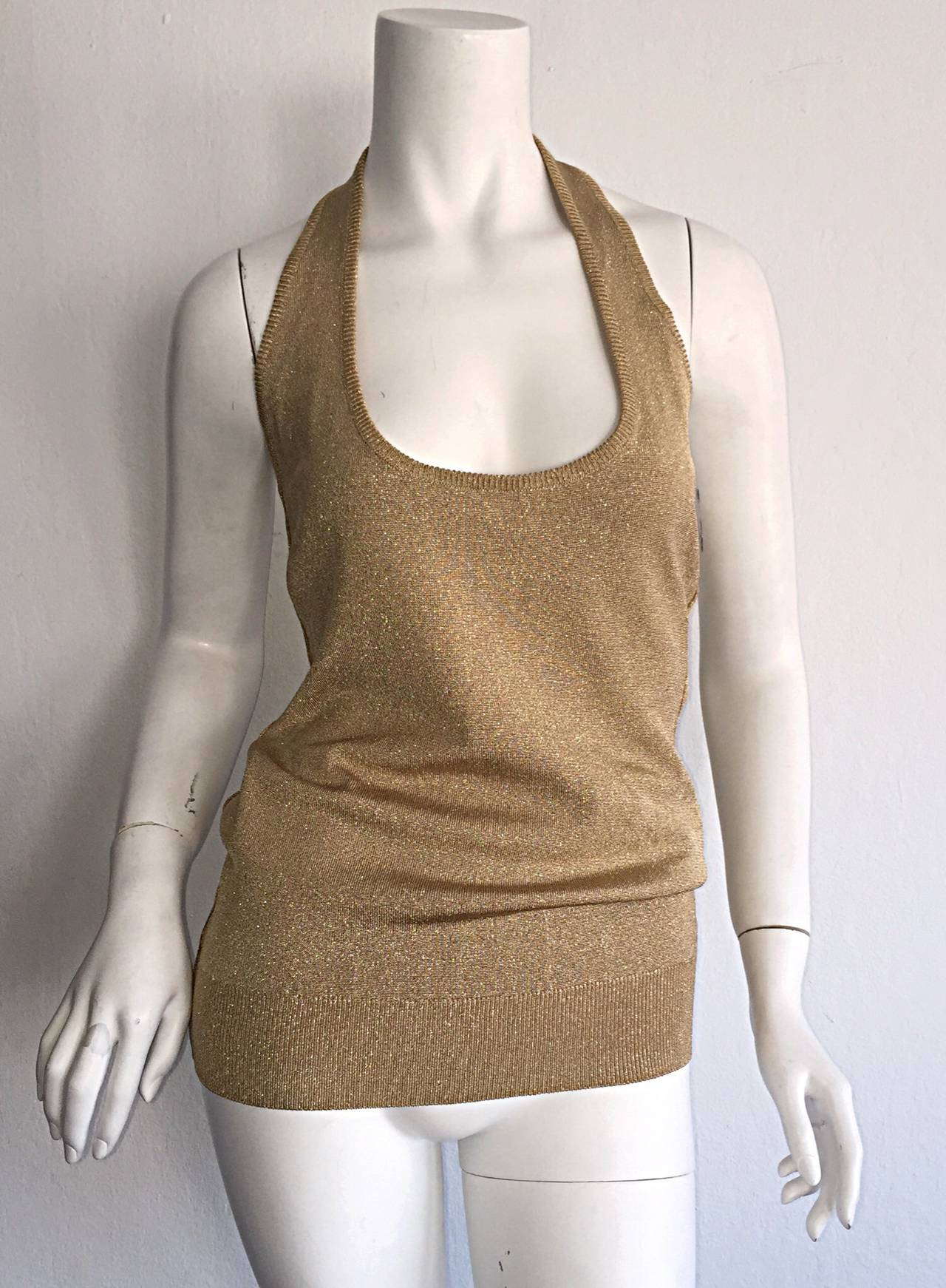 Beautiful brand new (with tags) vintage Donna Karan gold metallic halter top! Muted gold sparkle that is extremely versatile. Amazing under a sharp, fitted blazer! Looks great with shorts or denim. Perfect with wide legs trouser, skinny jeans, or