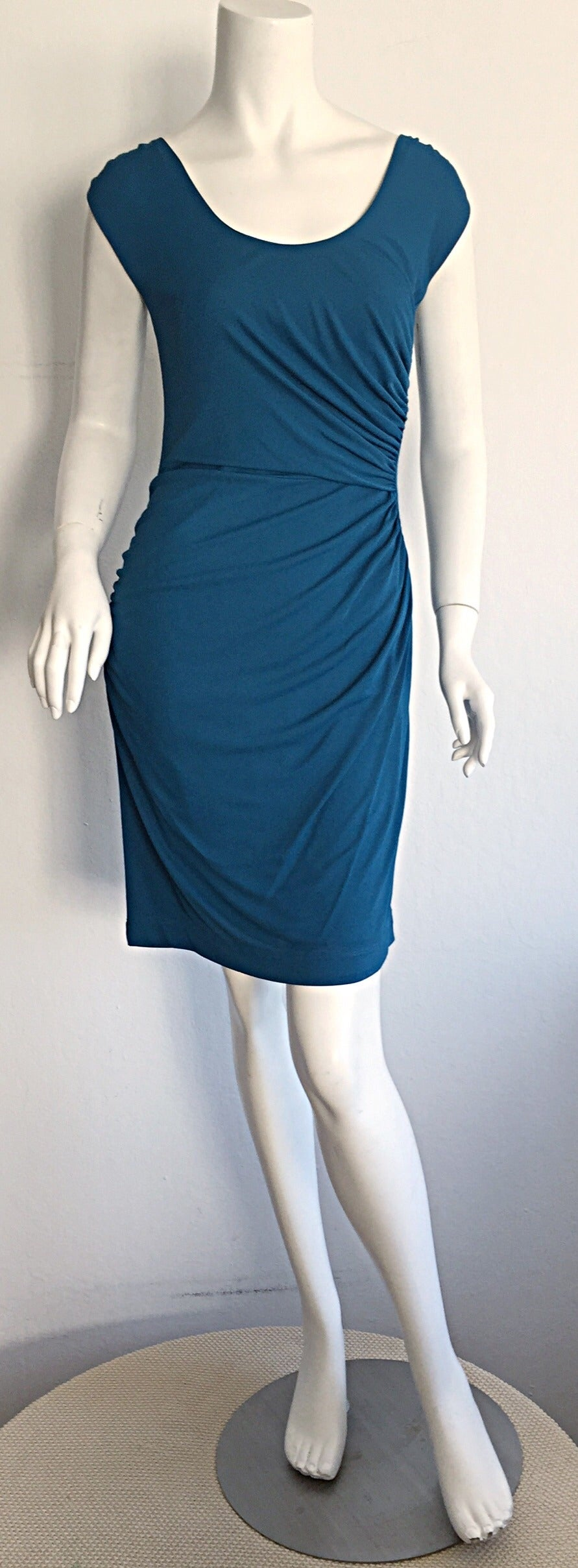 Beautiful blue 1990s Alberta Ferretti draped Grecian dress! Words cannot even begin to describe the mere beauty of this garment! The color, the fit, and the way in which this dress flatters the body make this a must have! Amazing construction on the