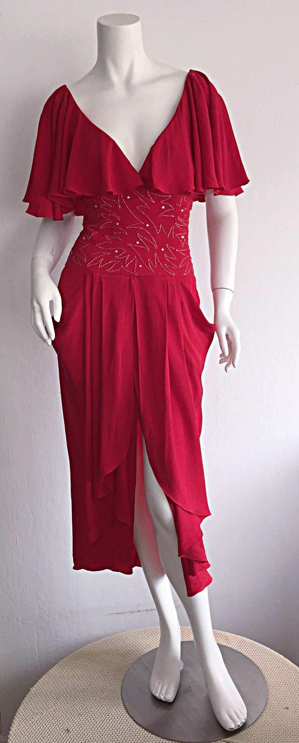 Beautiful vintage Eletra Casadei lipstic red dress! Casadei dresses are hard to come by, and when they arise, they are scooped up quick! This beauty is a prime of example of that reason! Extremely flattering fit, with a sweetheart neckline, fitted