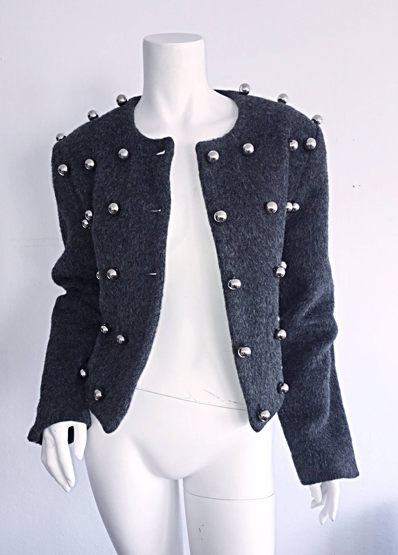 Incredible vintage Patrick Kelly charcoal gray jacket! Adorned with silver balls throughout the front of the jacket, with the five middle silver balls serving as buttons up the front. Perfect for the office, with jeans, or over a cocktail dress. Can