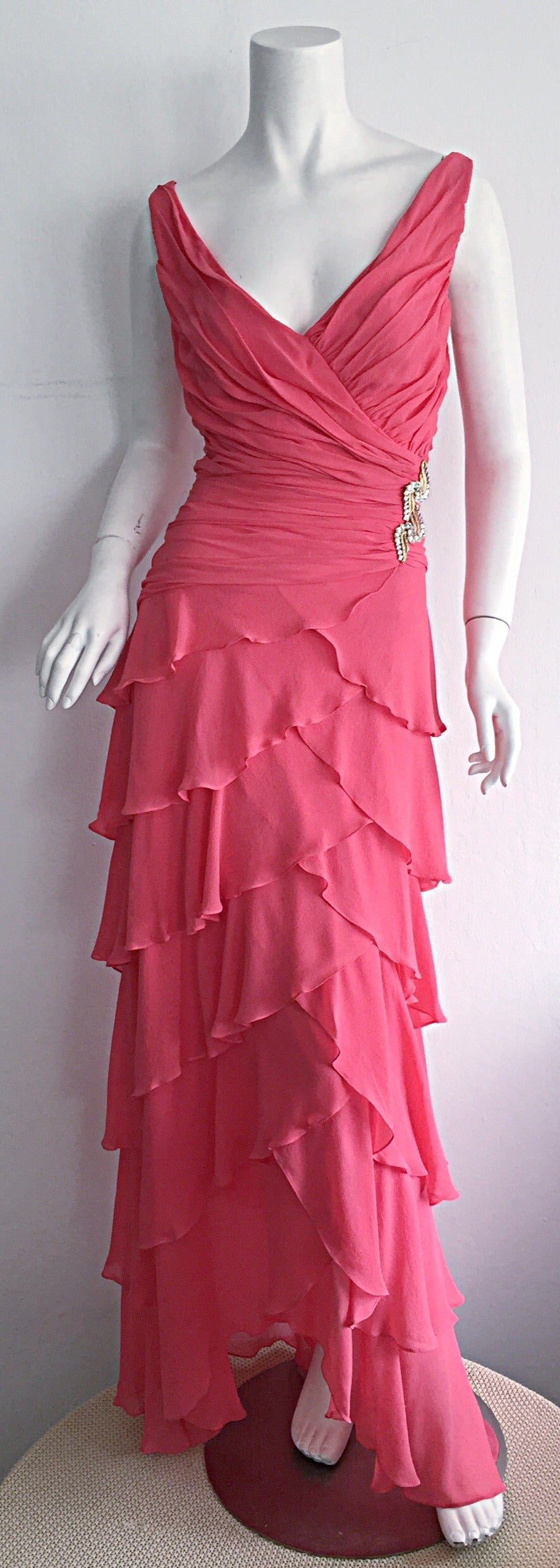 Gorgeous 1990s Tadashi Shoji pink silk chiffon tiered dress! Incredibly flattering bust, with layers of tiers throughout the entire gown, that look great with movement! Rhinestone details at side waist. Asymmetrical hem. Looks beautiful on! In great