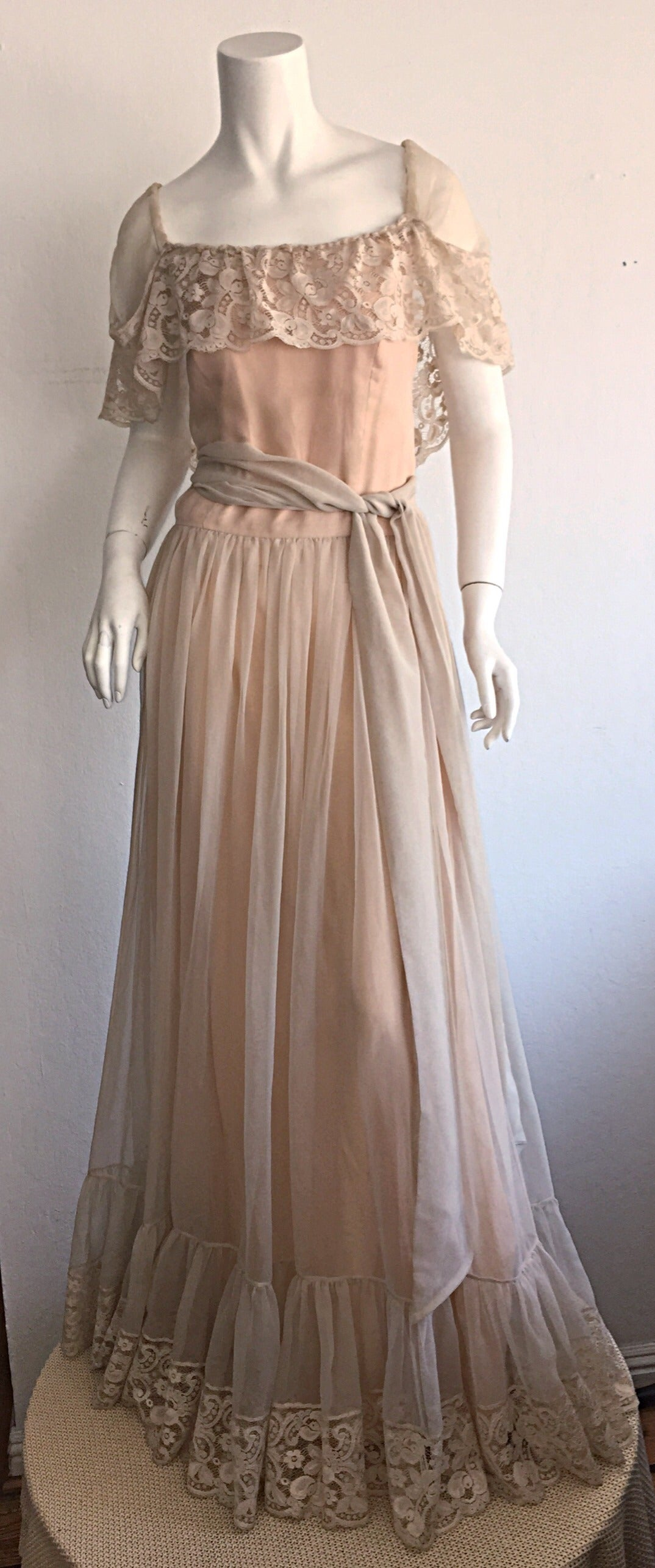 Absolutely beautiful, ethereal vintage Victor Costa cream lace maxi dress/gown, with detachable sash belt! Incredible amount of detail on this beauty! Can be worn on the shoulders, or off-shoulder. Perfect for any occasion, including as a wedding