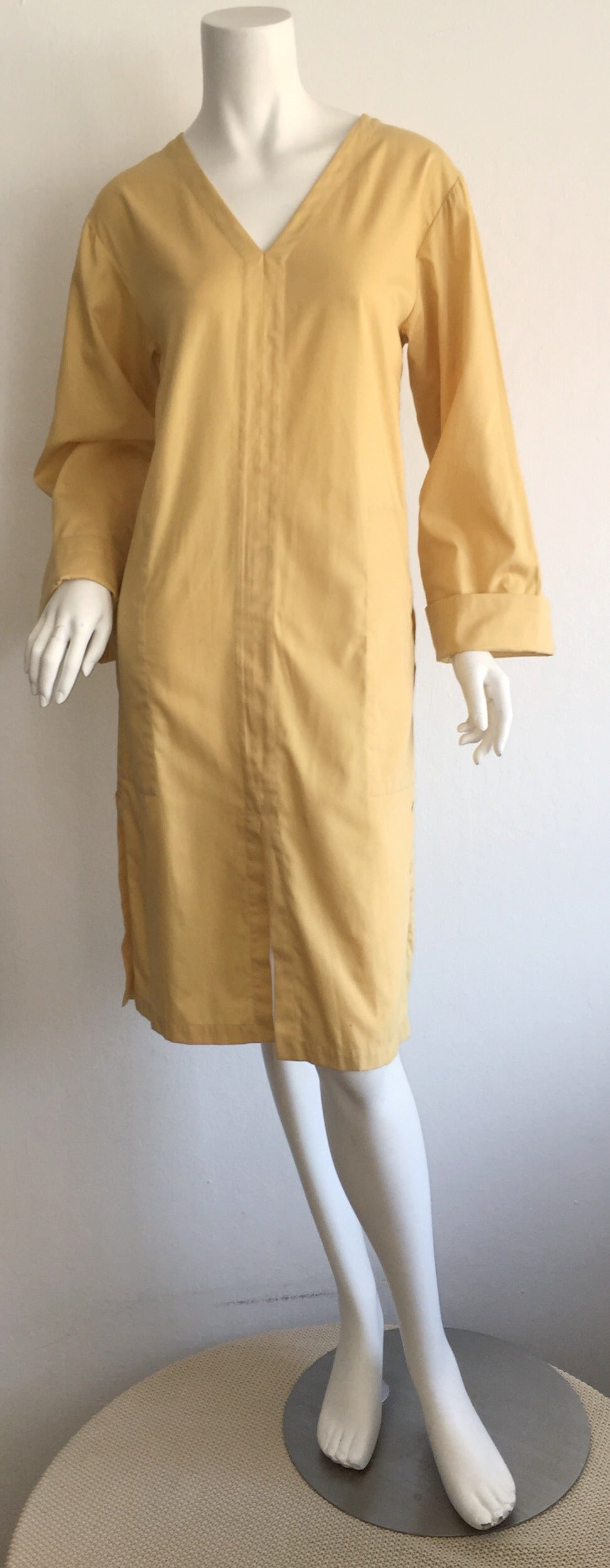 """Perfect vintage Yves Saint Laurent """"Rive Gauche"""" muted yellow cotton tunic/dress! Perfect as a dress or a tunic....great over a swimsuit! V-neck style, with pockets at both sides of waist. Soft cotton, with slits at front, and on both"""