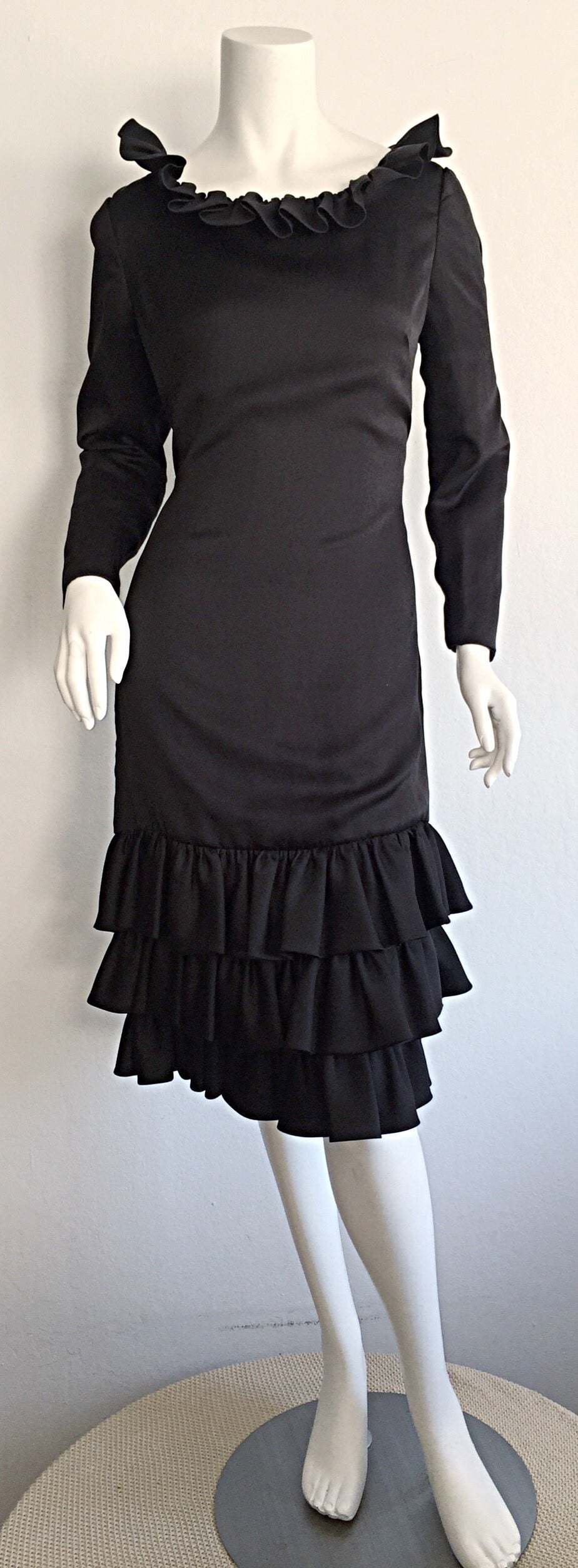 Beautiful 1960s Adele Simpson black silk dress! The PERFECT 'little black dress!' Features three tiers of ruffles at hem, with matching ruffle at neck. Such a chic, classic dress. Looks great alone, or with a belt. Fully lined. Hidden zipper up the