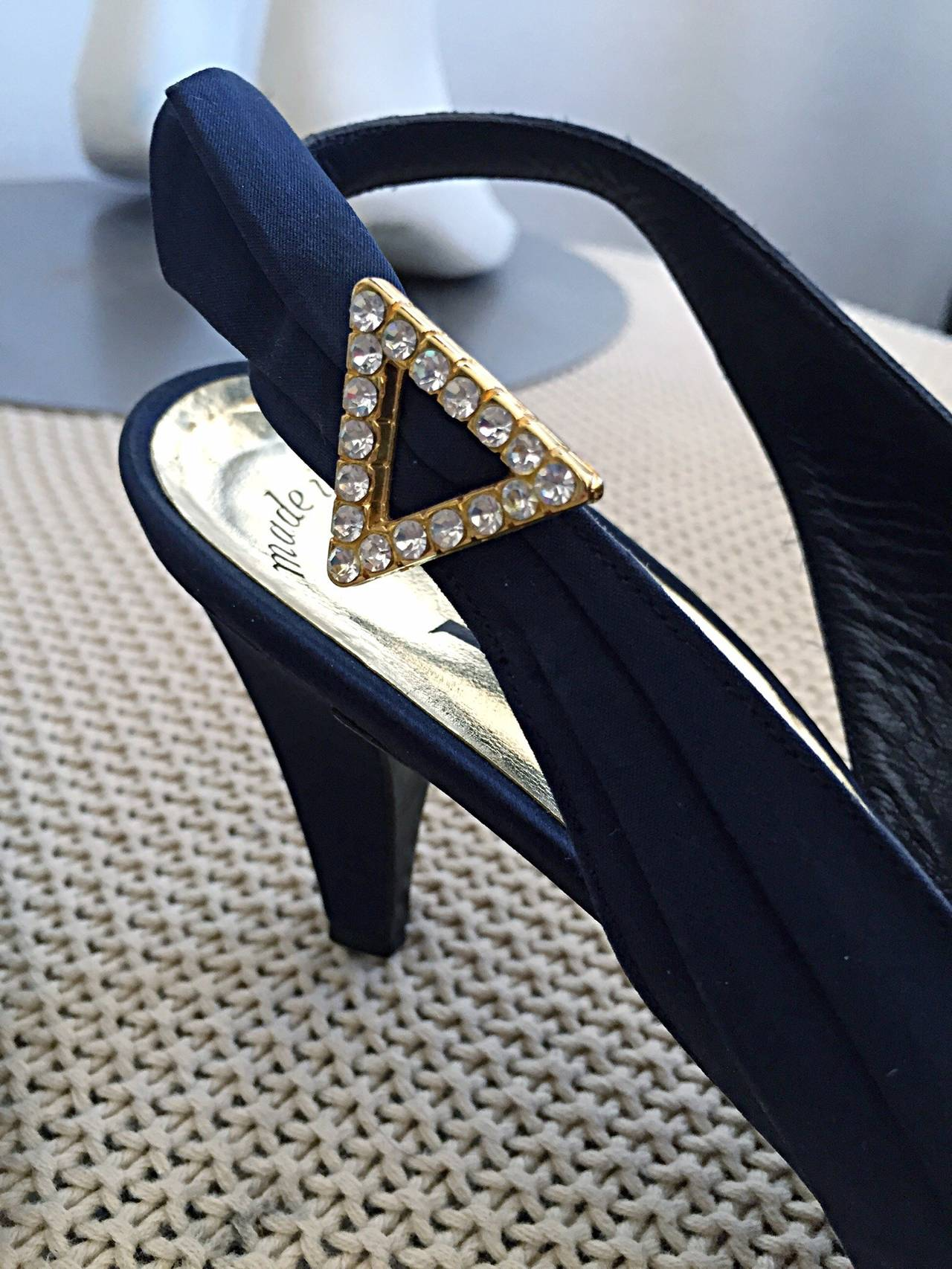 Beautiful vintage Yves Saint Laurent navy blue heels! Avant Garde detailing, with 'wings' at each outer side. Triangle rhinestone detail that accents the 'wings.' Architectural slanted vamp that is very flattering. Absolutely stunning in person! In
