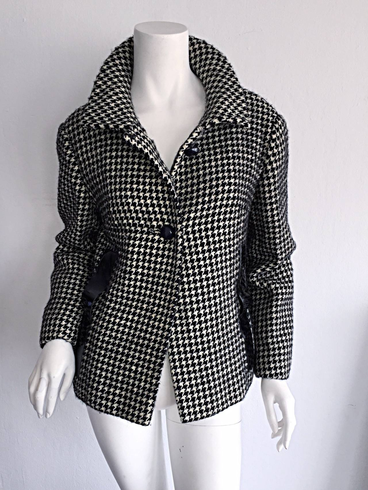Incredible and Rare! Vintage 1960s Pierre Cardin Couture black and white houndstooth swing jacket! Signature vinyl detail at either side of waist. An amazing piece of fashion history! Looks great from day to night. Made in France. In great