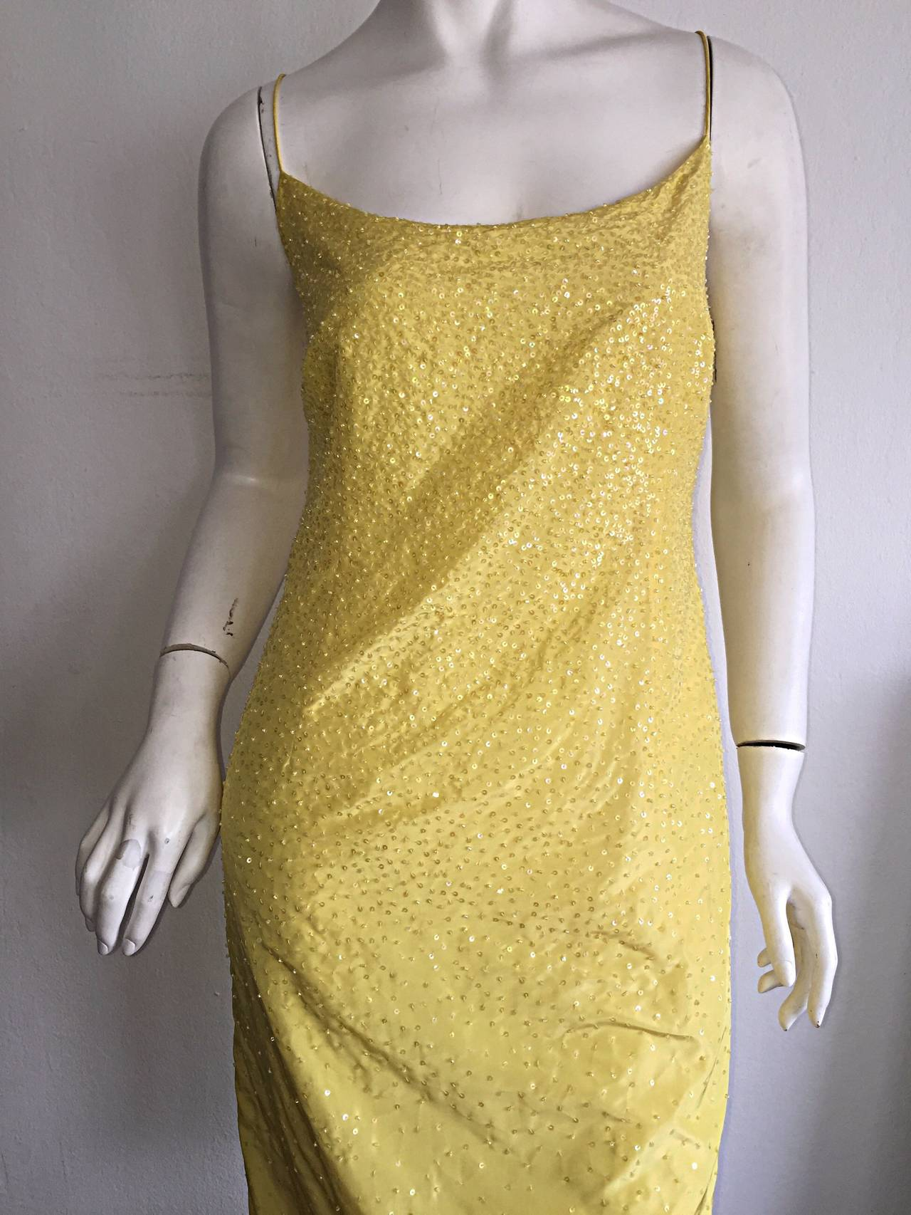 Stunning vintage Donna Karan canary yellow beaded silk dress! Thin spaghetti straps, with a figure flattering shape! Beads and sequins throughout front and back. Looks great alone, or can easily be belted. Perfect with sandals, wedges or heels! In