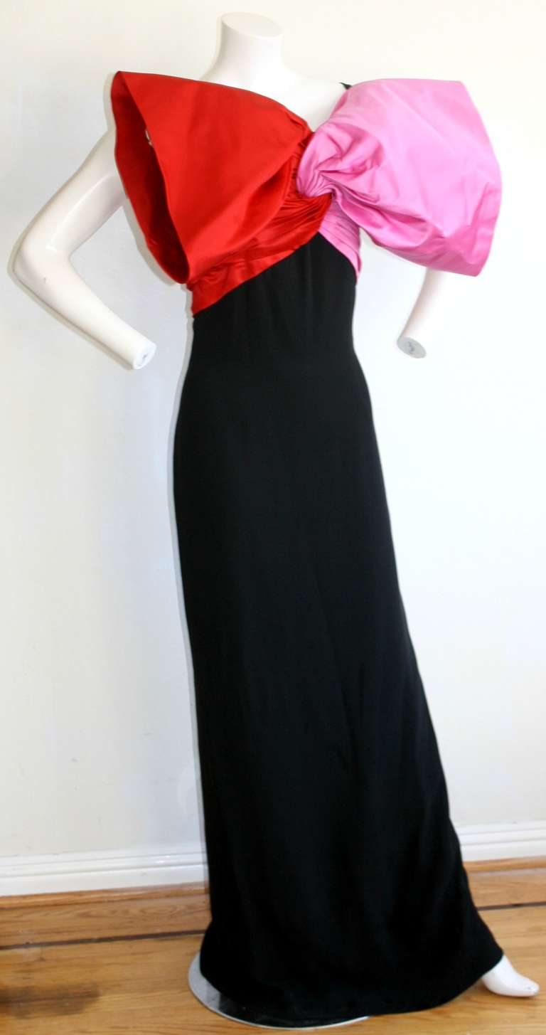 Breathtaking vintage Bill Blass Avant Garde bow gown! Features oversized red and fuchsia silk bow at bust. Built-in support corset. Sexy A-line back straps, with hidden zipper. A definite statement piece, with an extremely flattering fit. In great