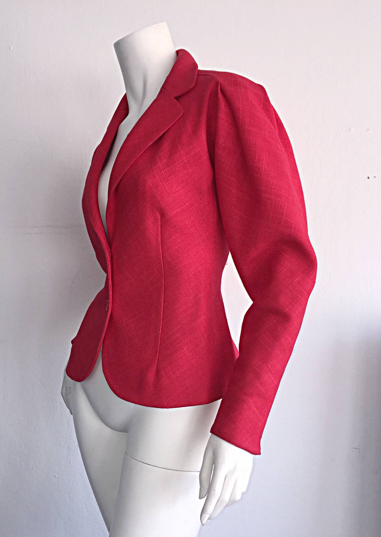 Beautiful vintage Halston linen blazer! Vibrant candy apple red color. Intricate, feminine details, and stitching at sleeves. Two red buttons up the front. Can easiily be dressed up or down. Looks fantastic with jeans, trousers, or a skirt! Fully