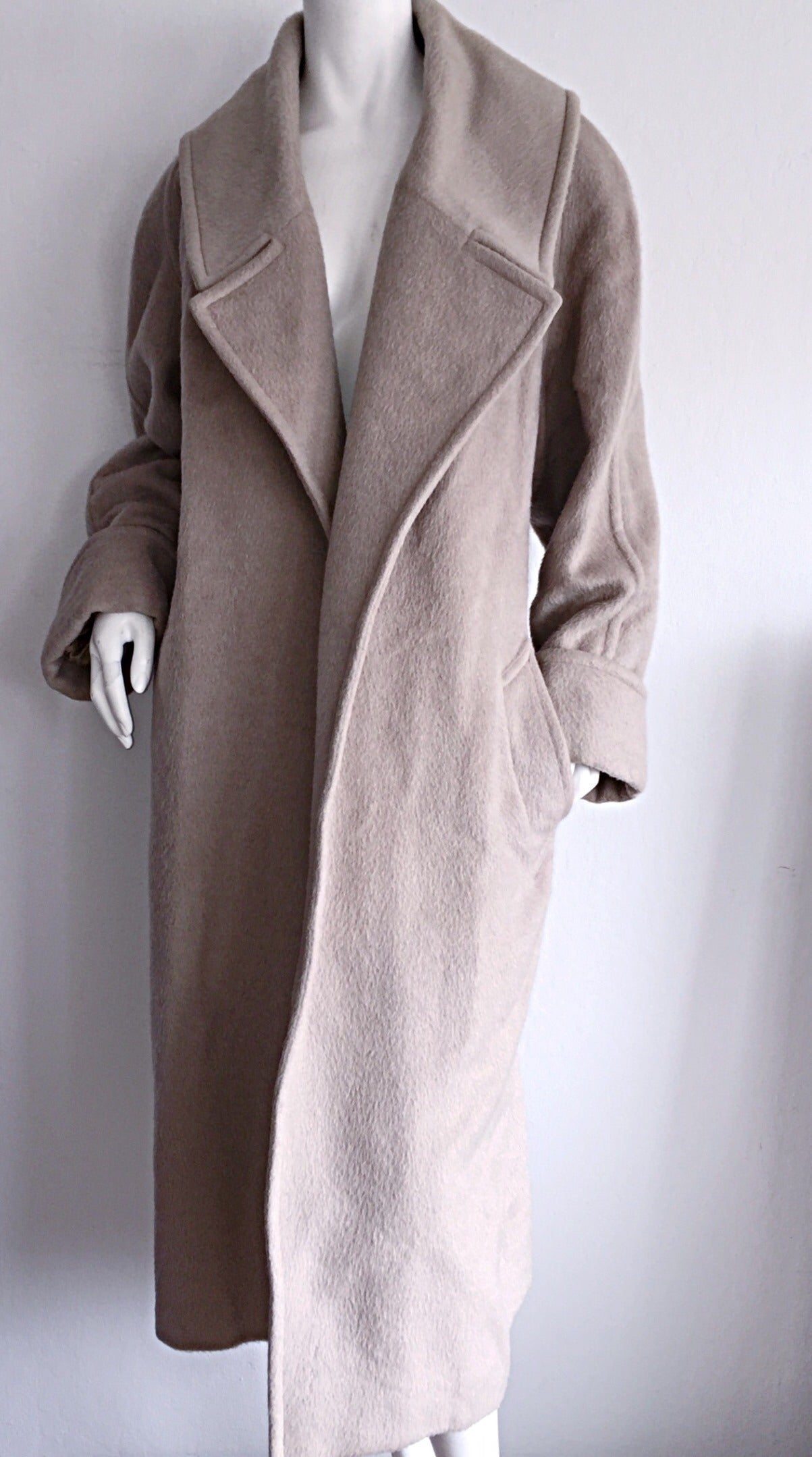 Fabulous vintage Guy Laroche blanket coat! Words cannot even begin to describe how stylish, yet utterly comfortable this jacket is!!! Wool and Alpaca blend. Neutral taupe color, that goes with everything. Belt can be worn a number of ways. Can be