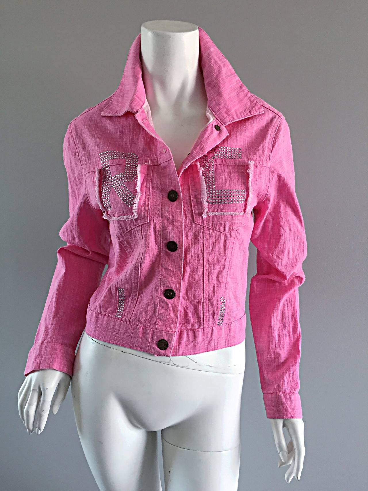 "Amazing vintage Roberto Cavalli 'Barbie' pink jean jacket! Features rhinestones at bust, that spell out ""RC."" The perfect statement jacket that can be worn in so many ways. 100% Cotton. Made in Italy. In great condition. Approximately Size"