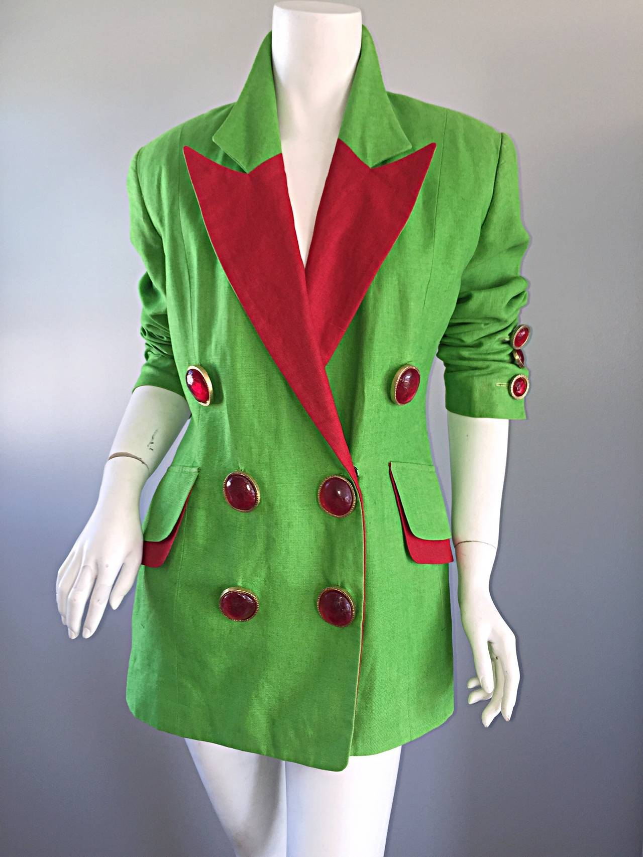 Incredible vintage Gemma Kahng avant garde blazer! Vibrant green color, with pos of red throughout! Oversized red gripoix buttons on the front, and at sleeve cuffs. Double breasted style. Large lapels. Can be worn a variety of ways. Fully lined. In