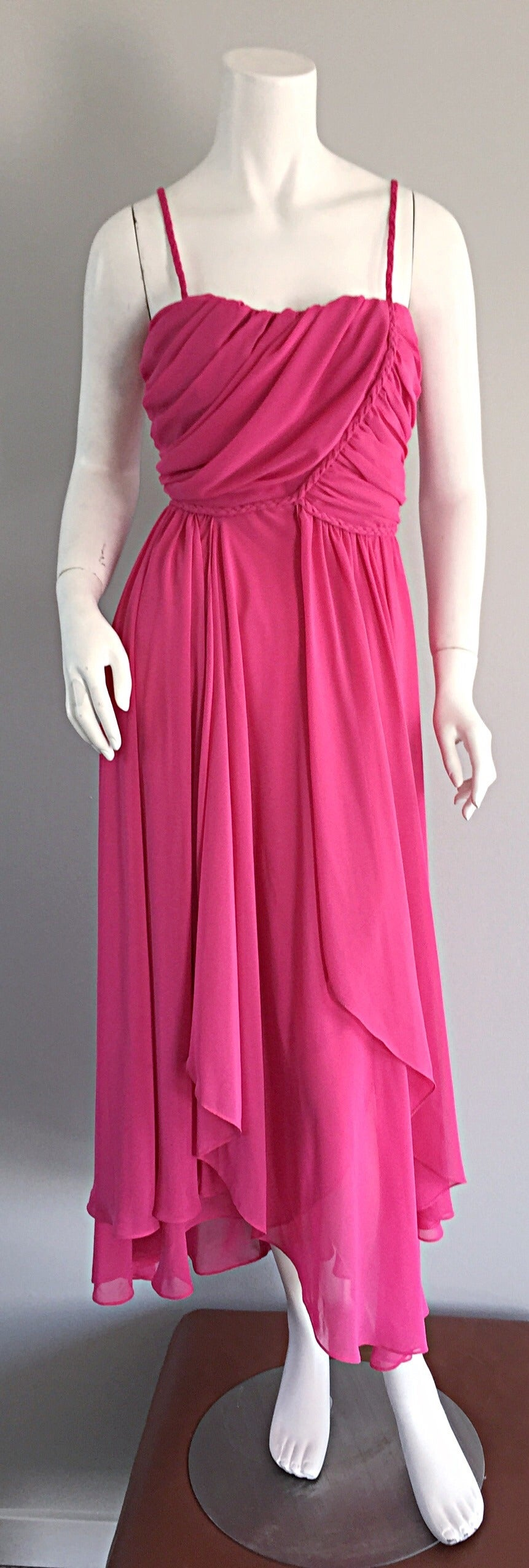 Gorgeous vintage Joy Stevens disco dress! Hot pink color, with an incredible amount of detail. Layers and layers of flowy pink asymmetrical panels. Flattering ruching at bust, with intricate braiding detail throughout, including braided shoulder