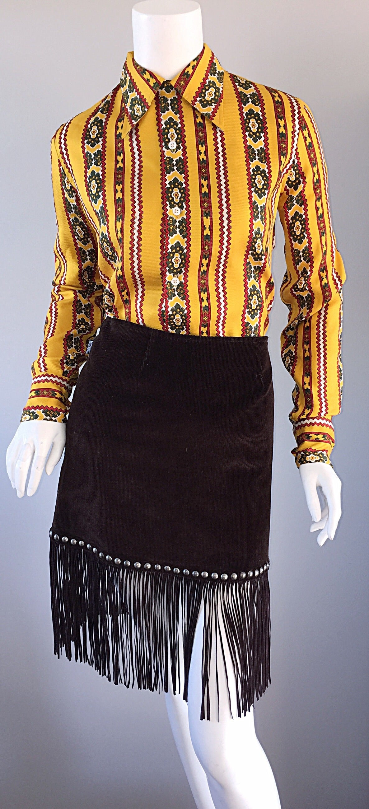"Super rare vintage 80s Ralph Lauren ""Blue Label"" silk blouse! Marigold color, with hues of burgundy, green, white and yellow. 100% silk. Awesome tribal print! Buttons up the front, with hidden button at side collar. Great tailored fit. Looks great"