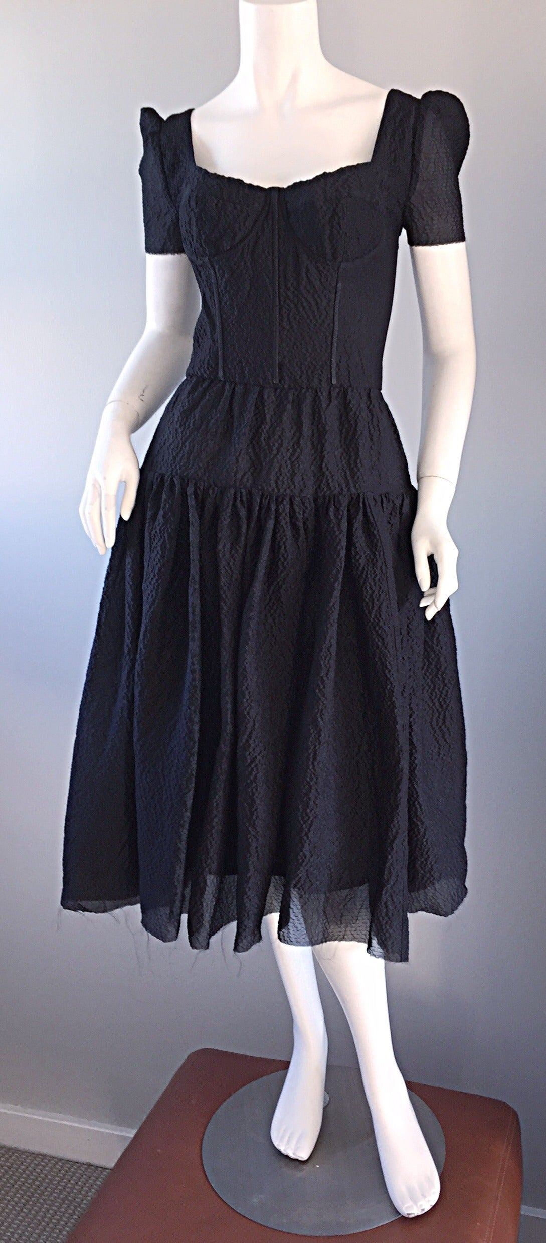 Beautiful brand new Dolce & Gabbana black silk dress! Signature bustier/corset style bodice. Insane amount of detail and workmanship was put into this dress, which retailed for $4,500! 1950s style, with an edge! Unfinished edges at hem. Silk covered