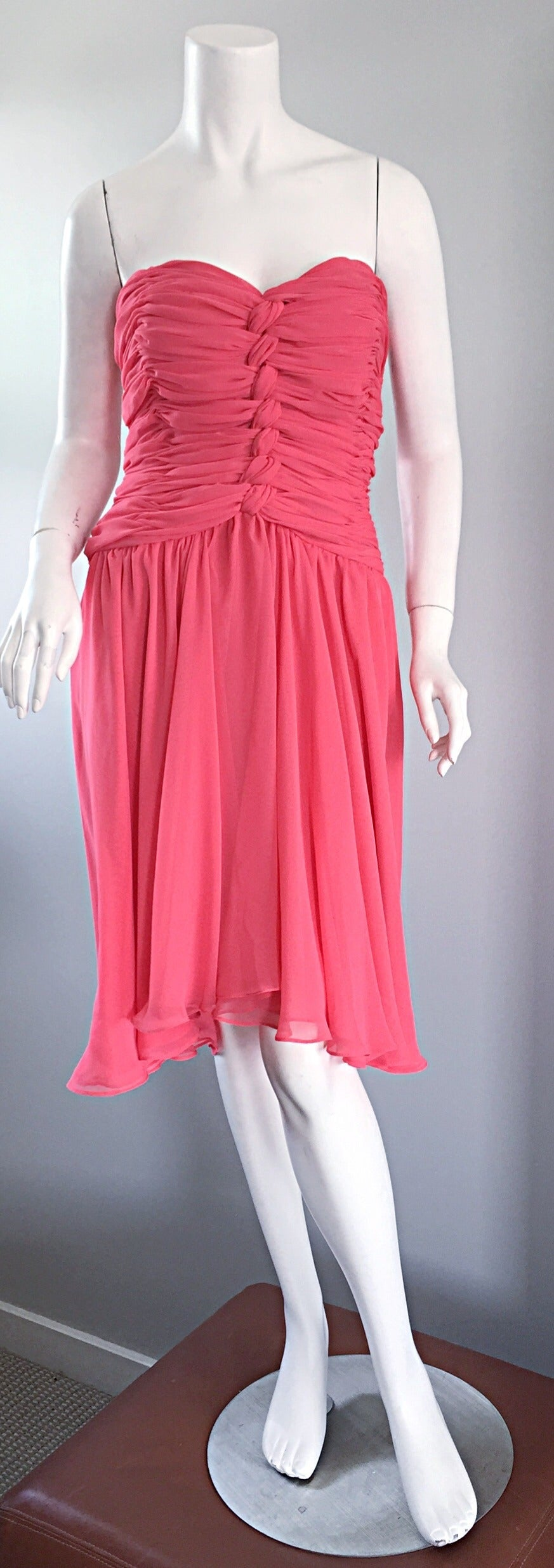Beautiful vintage Victor Costa coral/pink strapless dress! Light and flowy, this dress does wonders for the body! Ruching and knotting at bodice (on front and back), with layers of vibrant coral on the skirt. Looks great when walking, or on the