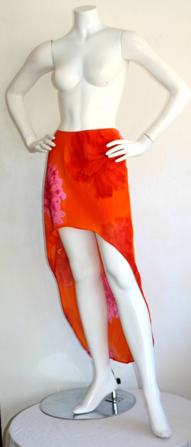 Beautiful vintage 1990s Pierre Cardin Runway skirt! Wonderfully sexy Mermaid hem, that features gorgeous floral abstracts. In great condition. Can fit many sizes due to stretch, and elastic waistband. Approximately Size Small - Medium
