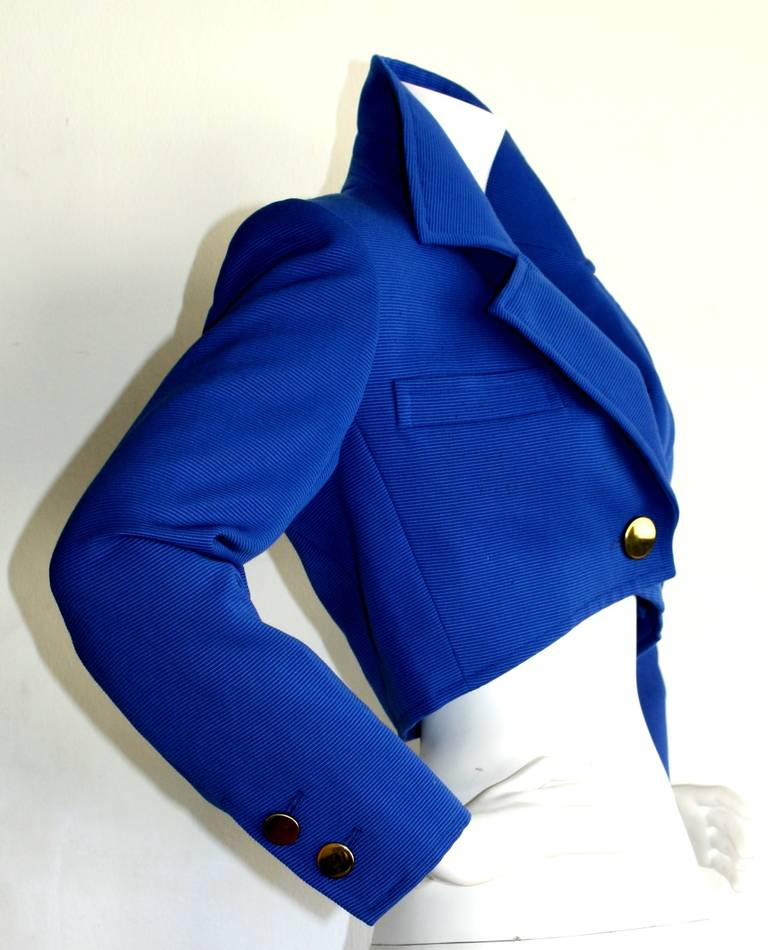 Vibrant royal blue vintage YSL cropped blazer/bolero. Features large gold buttons at waist and cuffs, with two spates sewn inside. Fully lined. In great condition. Marked size EU 34  29 inch waist