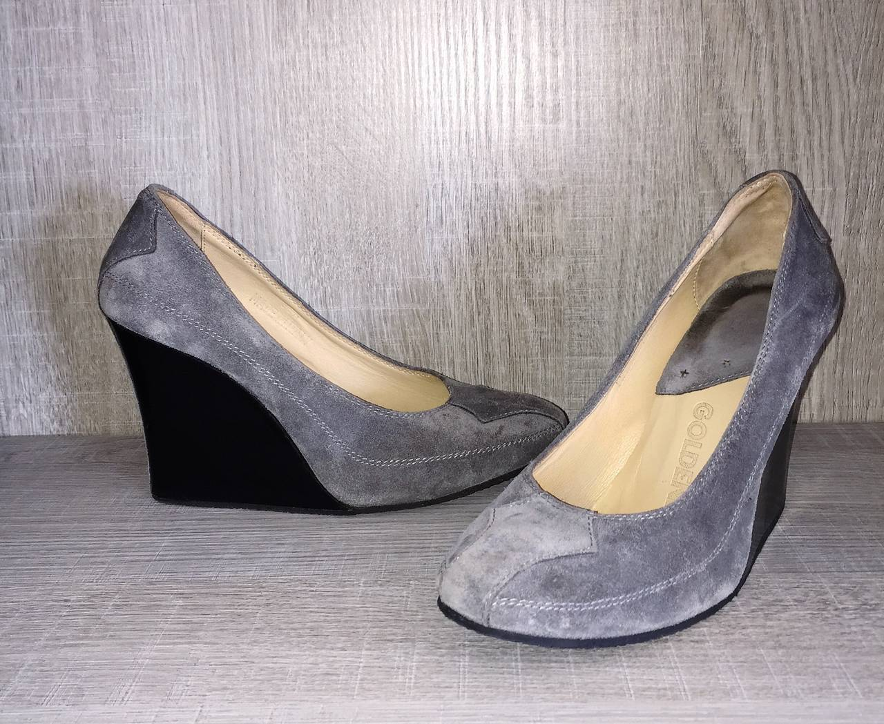 Brand new pair of Goldenbleu gray leather suede wedges! Never worn. Perfect gray color, that goes with everything! Optical illusion heel, that looks like a stiletto from the back, at first glance. Extremely comfortable, with a chic look---perfect