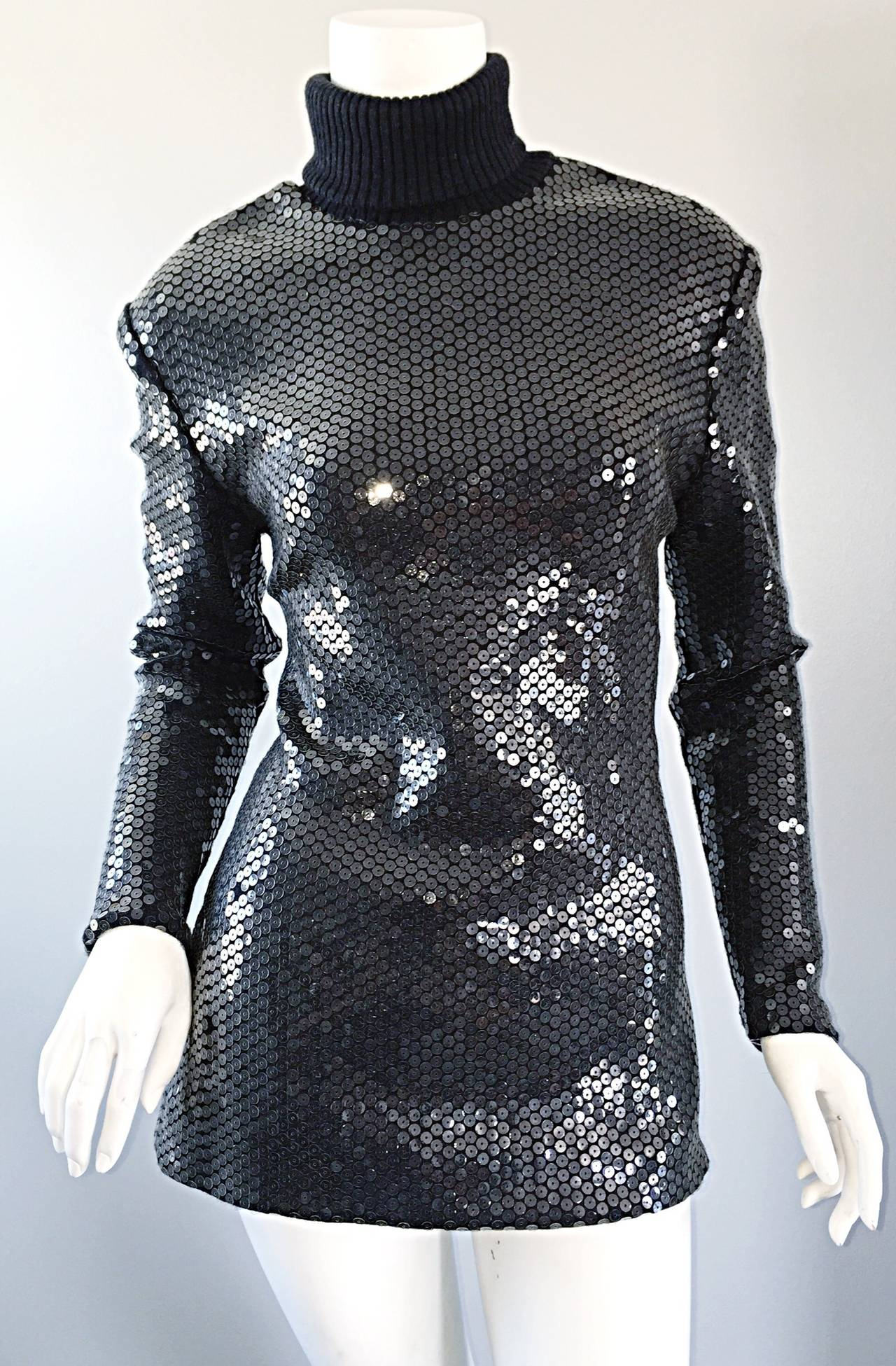 A very rare piece, dating from the very early career of Michael Kors! Runway sample sweater/turtleneck! Charcoal gray wool/cashmere, with all-over clear sequins. A classic, tailored fit, with light shoulder pads (can easily be snipped out). Vintage