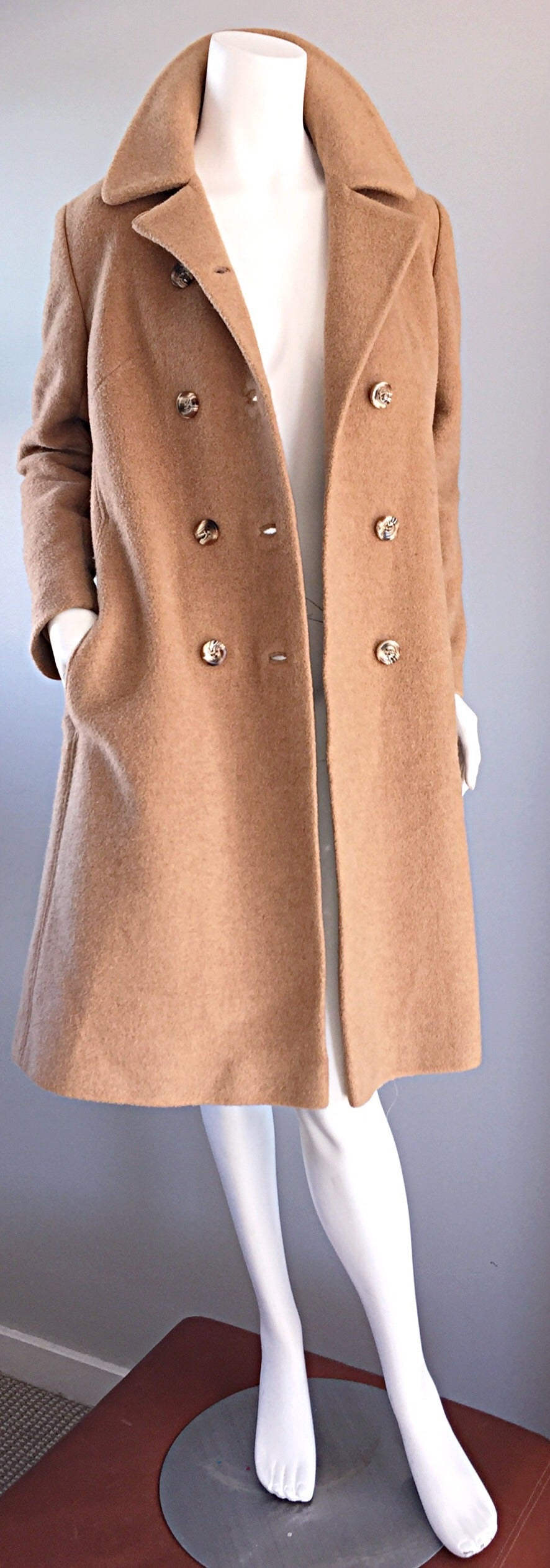 Classic 1960s camel hair jacket! Jackie-O style, with wonderful double breasted horn buttons. Timeless jacket, with so much style! Great tailored fit. Can be worn open or closed. Pockets at both sides of waist. Fully lined. In great condition.